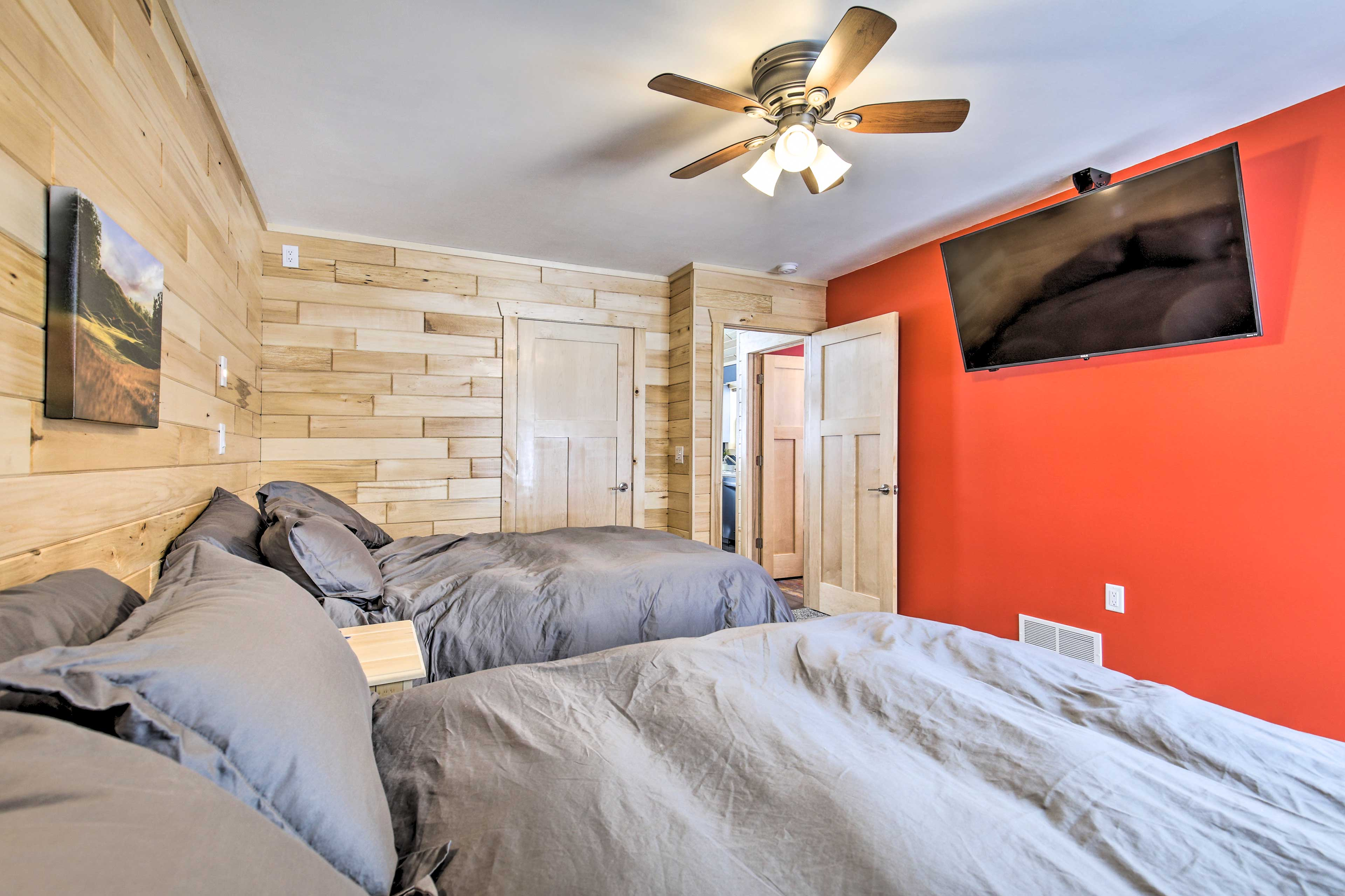 This room is outfitted with queen-sized beds.
