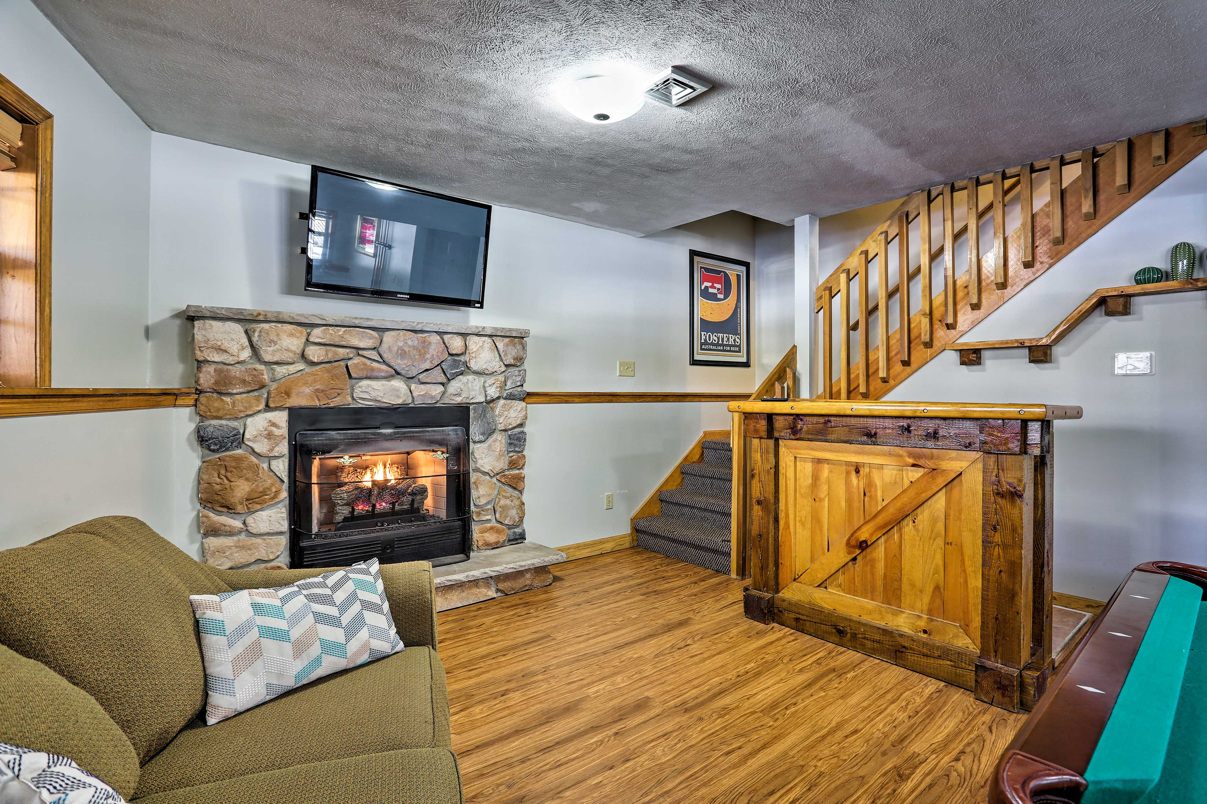 Warm up by the fireplace in the game room.