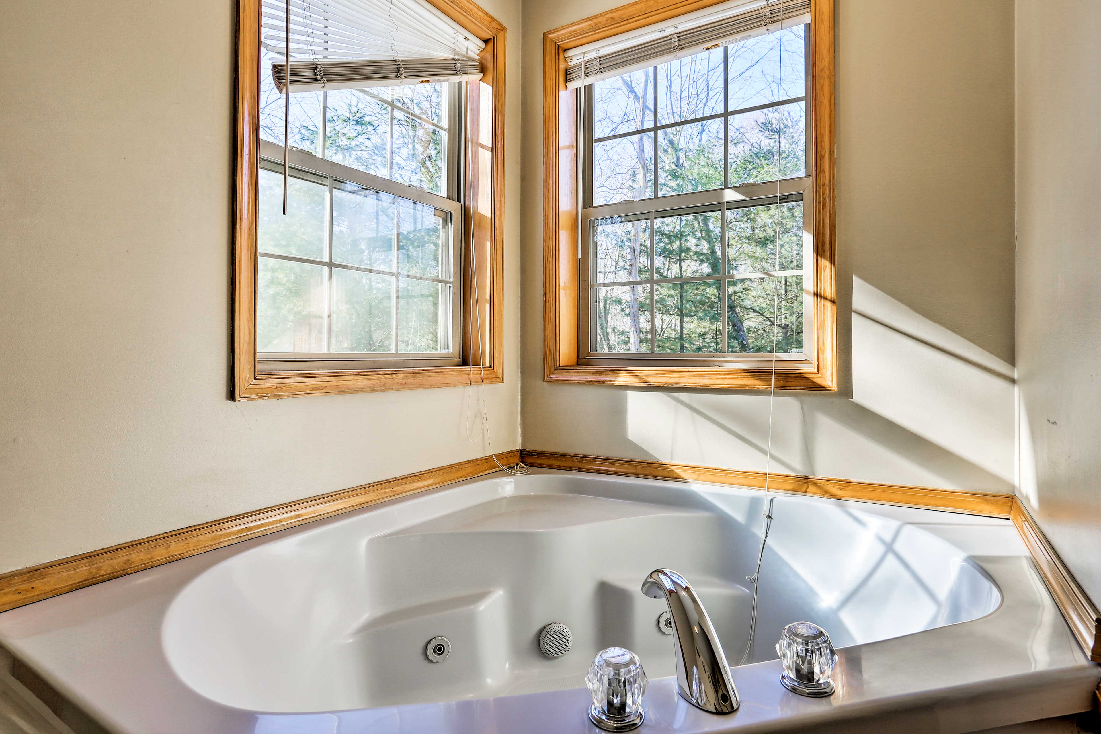 Take a warm bath in the master bedroom.