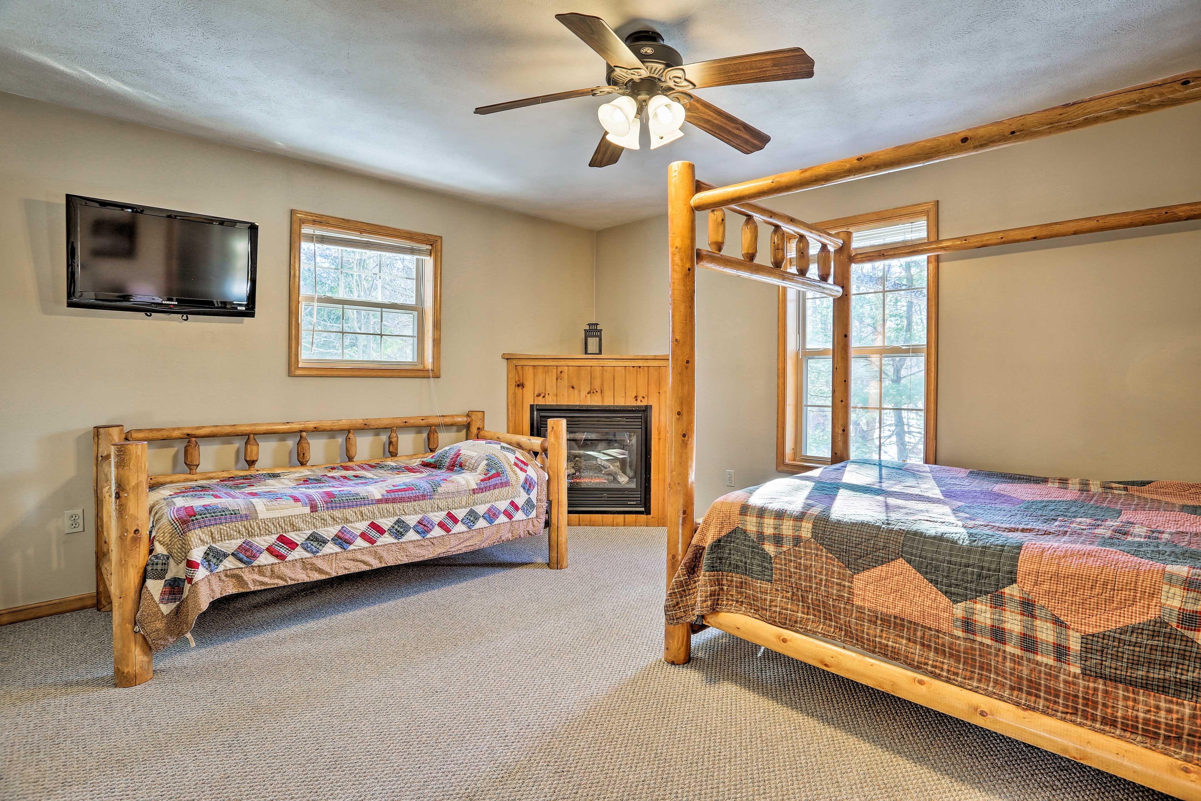 The master bedroom features a queen and twin bed.