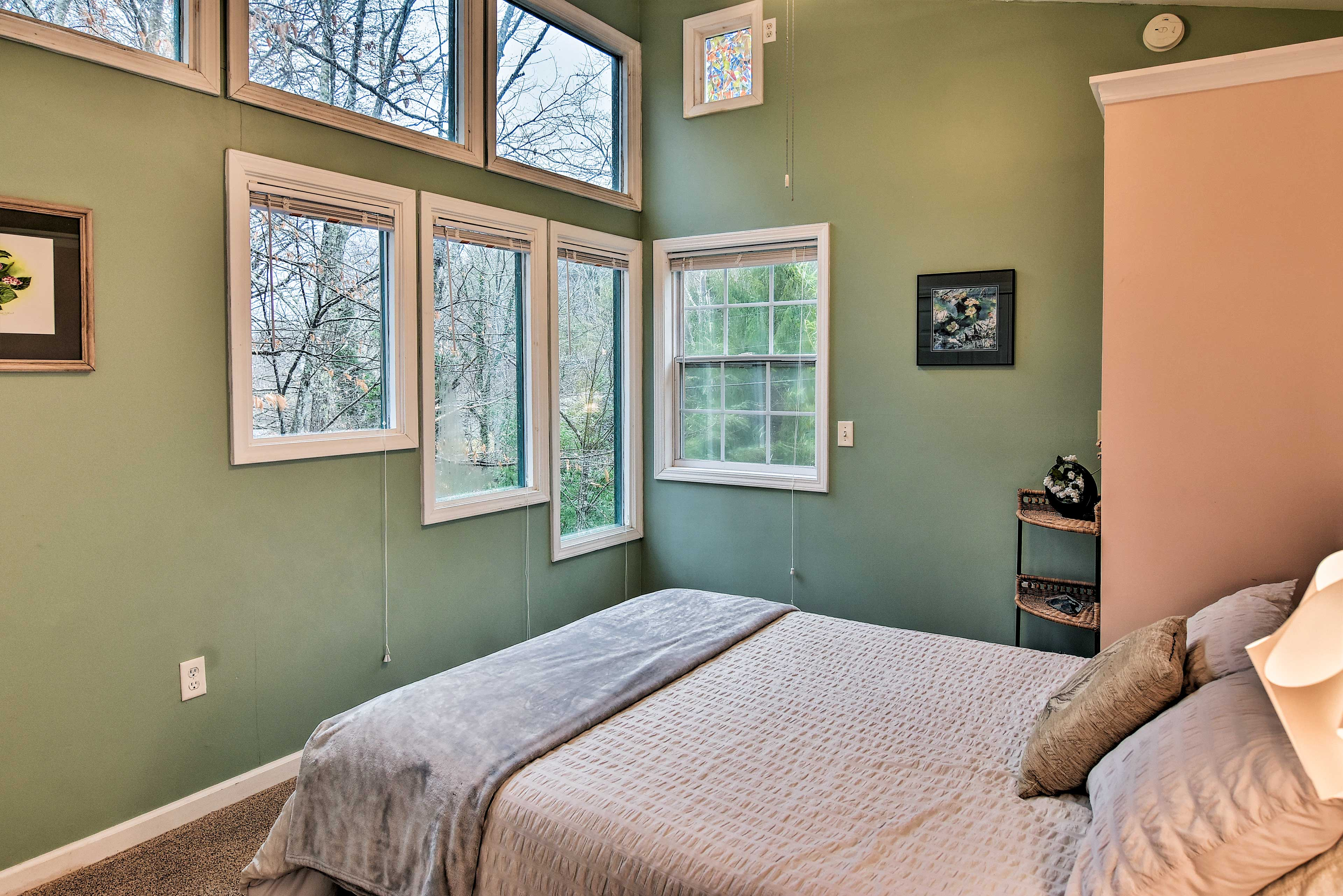 Watch the sun set over the mountains through the windows of the master bedroom.