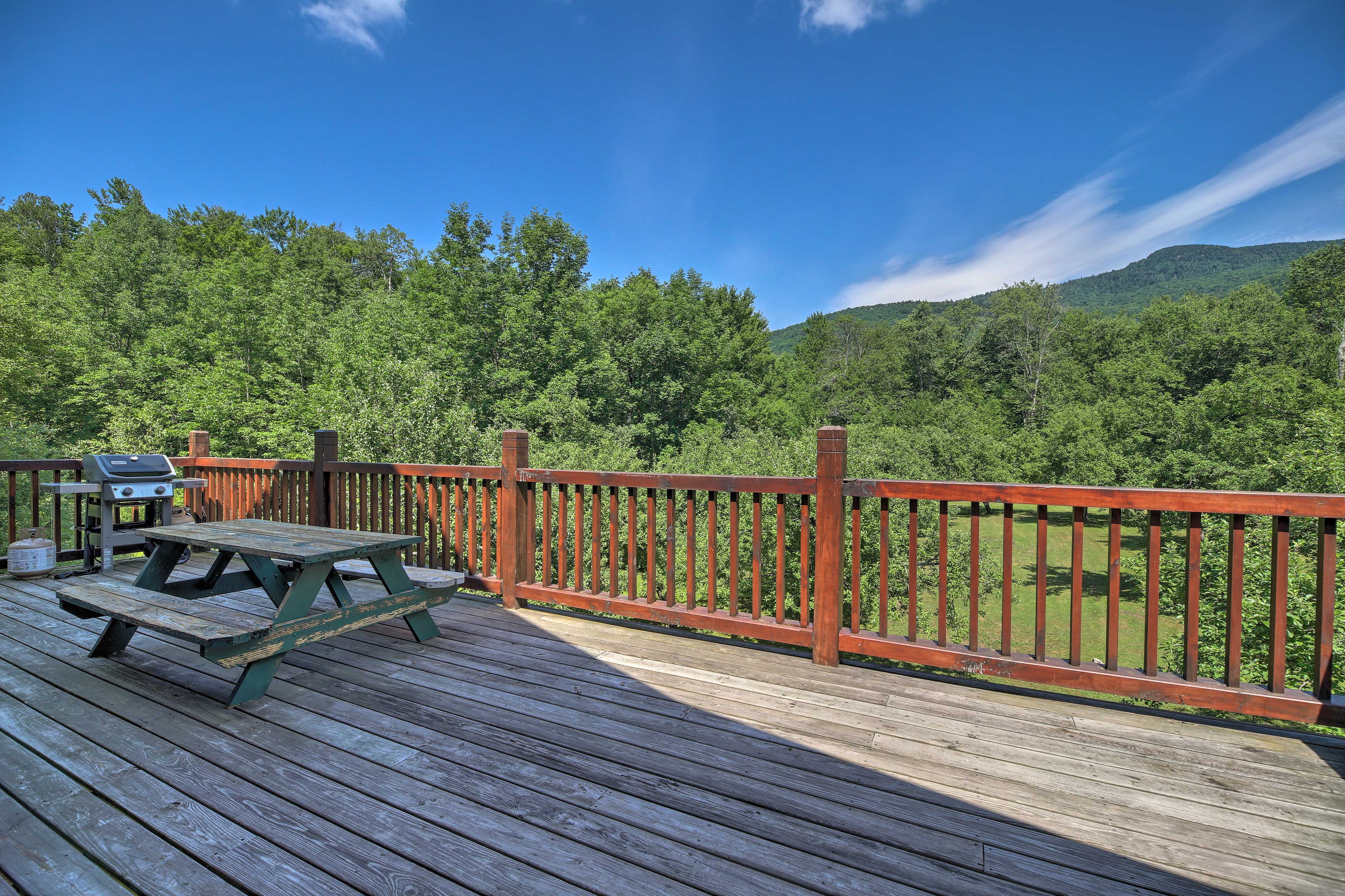 Sit on the deck and soak in the mountain views.