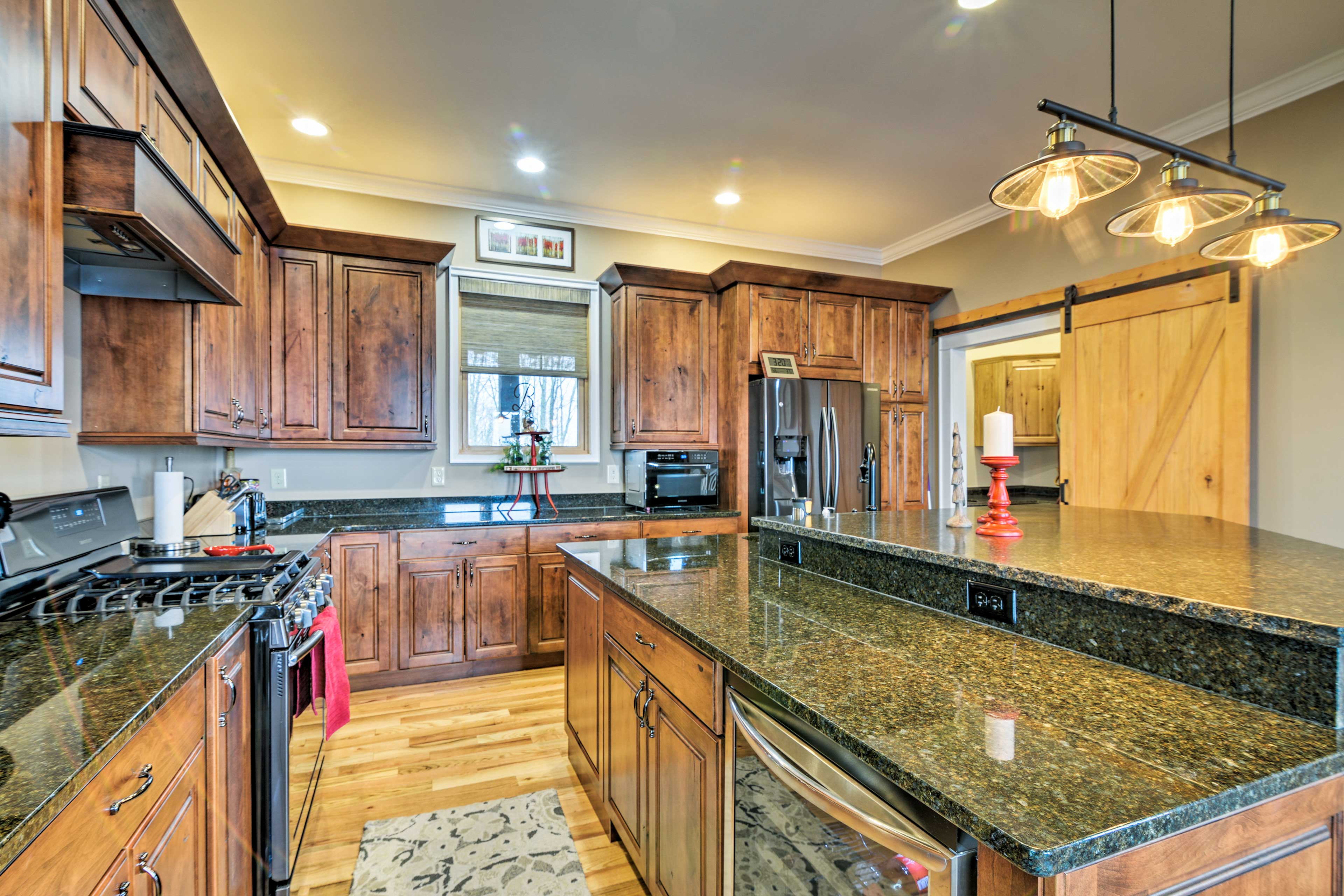 Granite countertops and stainless steel appliances complement the kitchen.