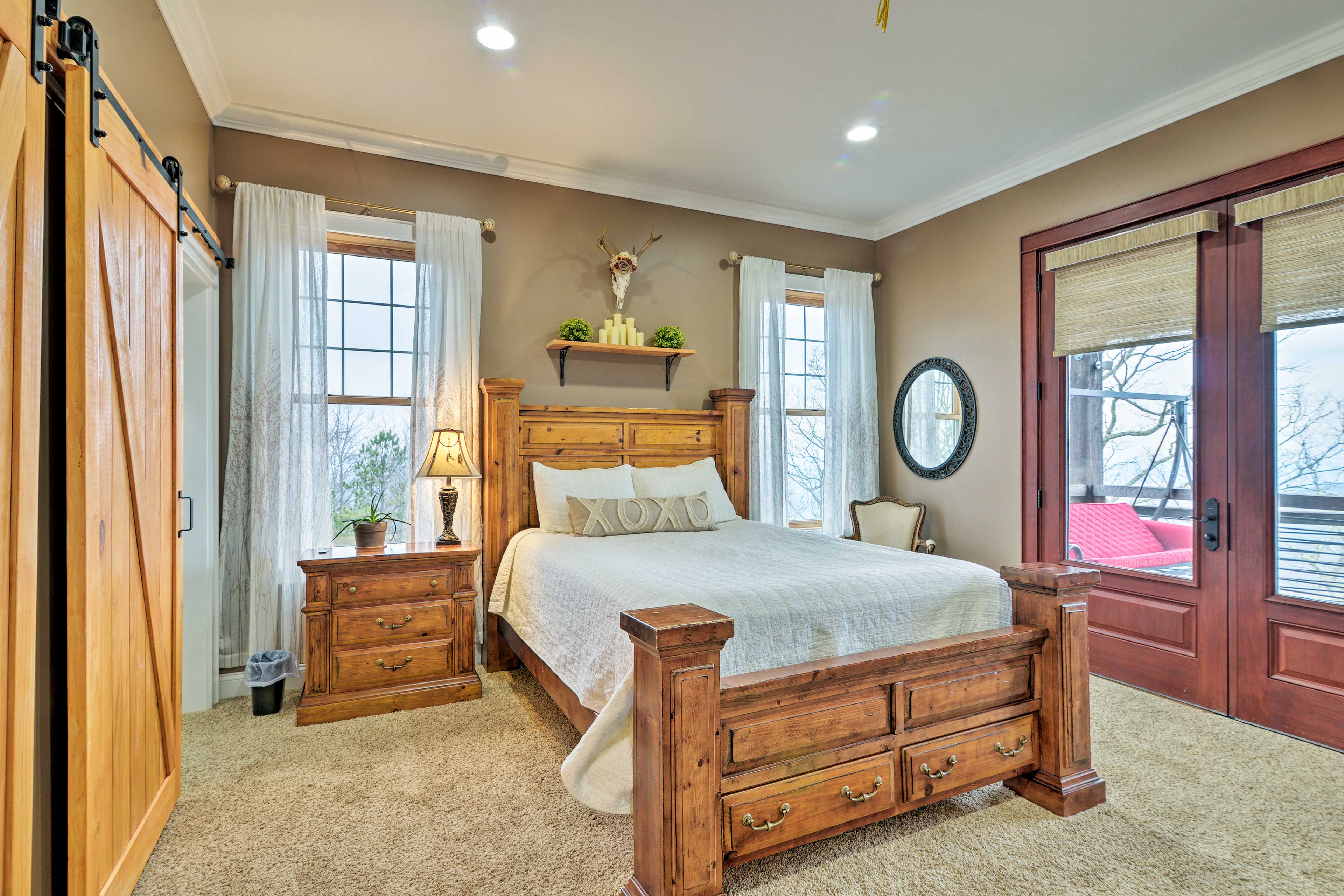 Enjoy the comfort of the queen-sized bed in the master suite.