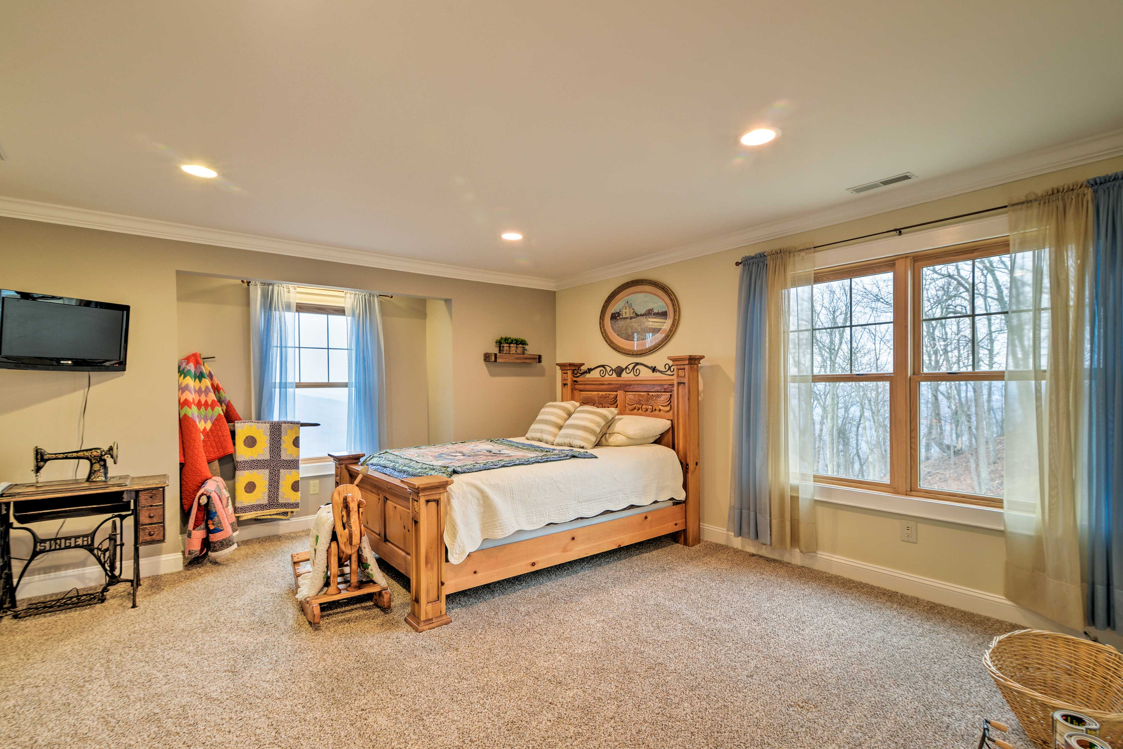 The third bedroom is also complete with a queen-sized bed.