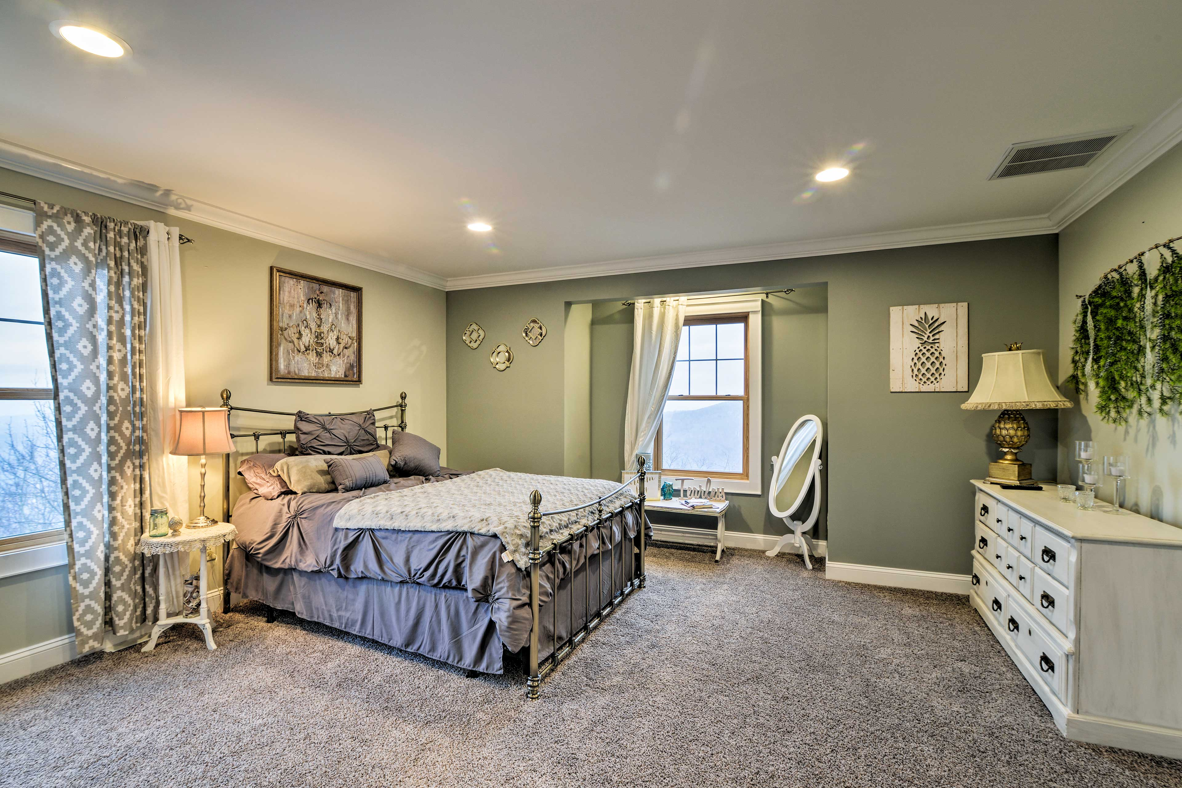 The second bedroom is equipped with a queen-sized bed.