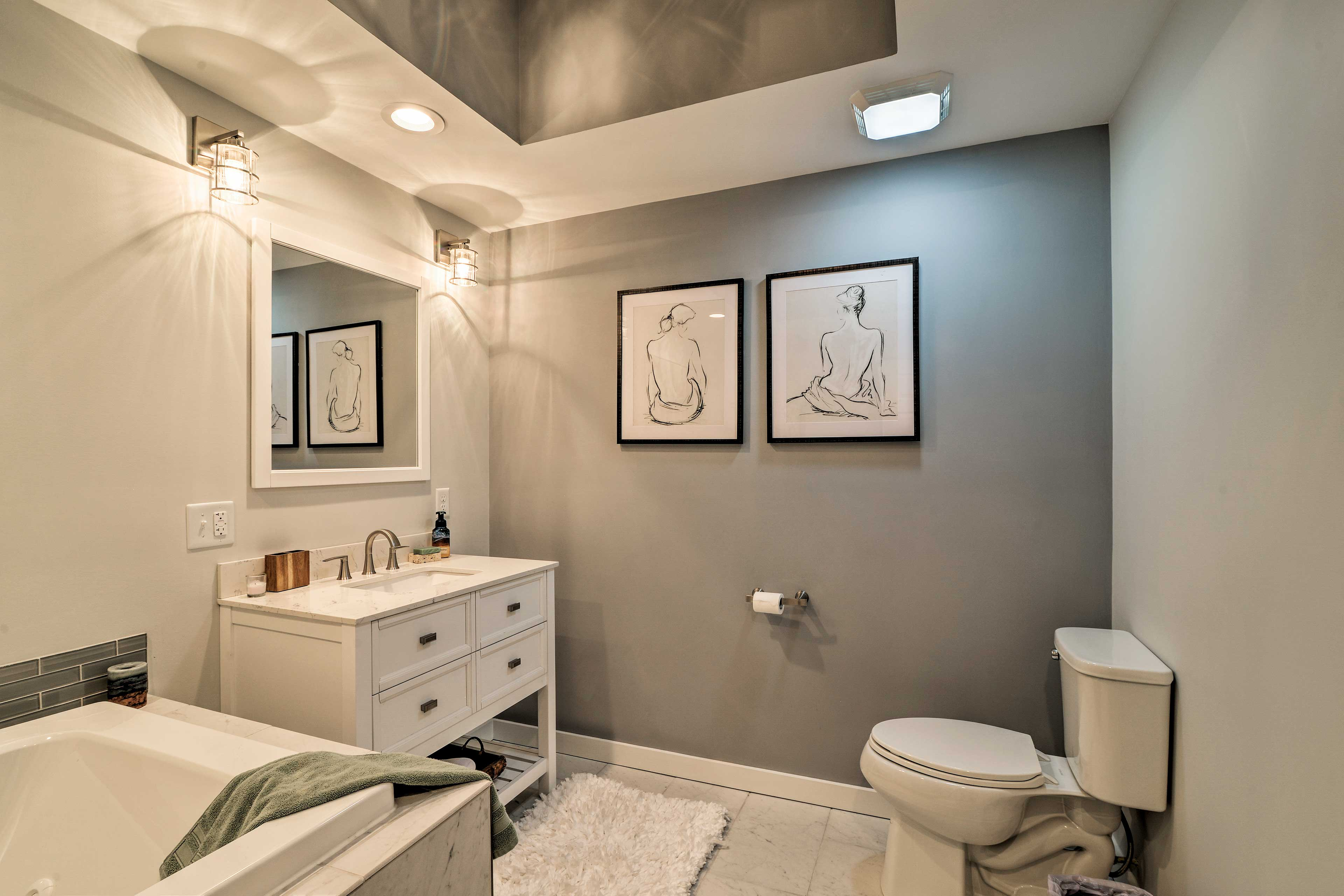 The downstairs also offers a luxurious full bath complete with a jetted tub.