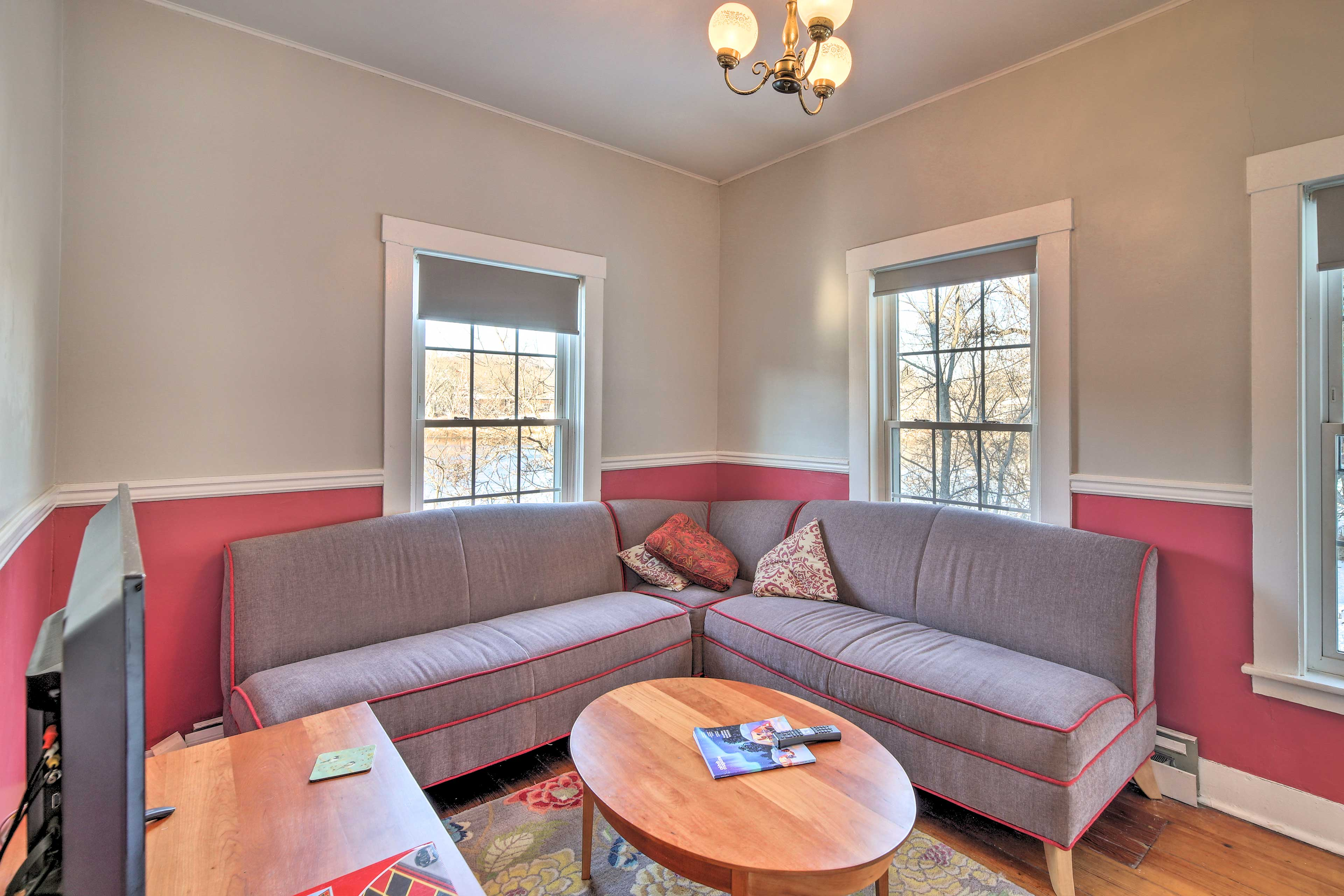 A second living area has an L-shaped sofa.
