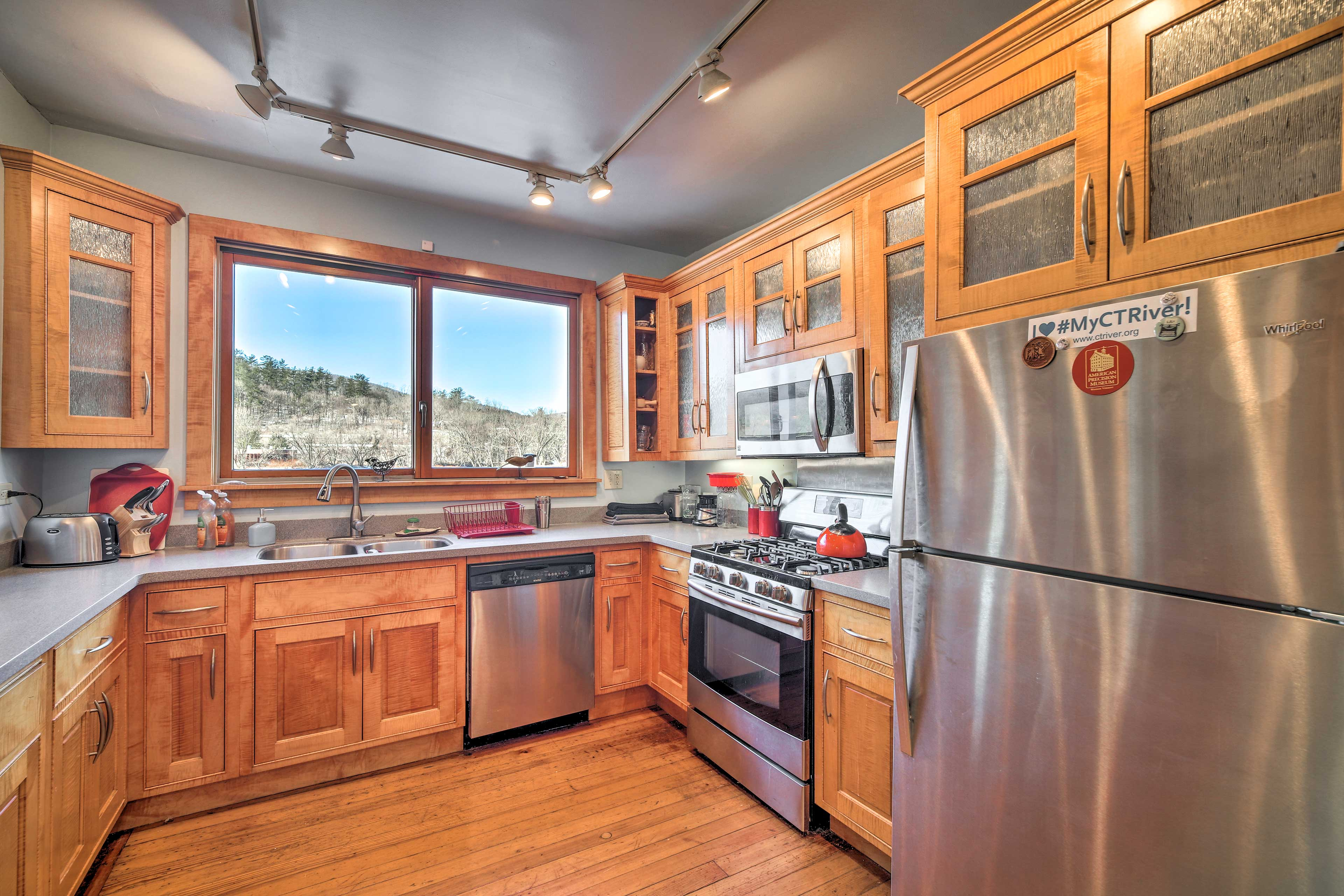 This kitchen is fully equipped with stainless steel appliances.