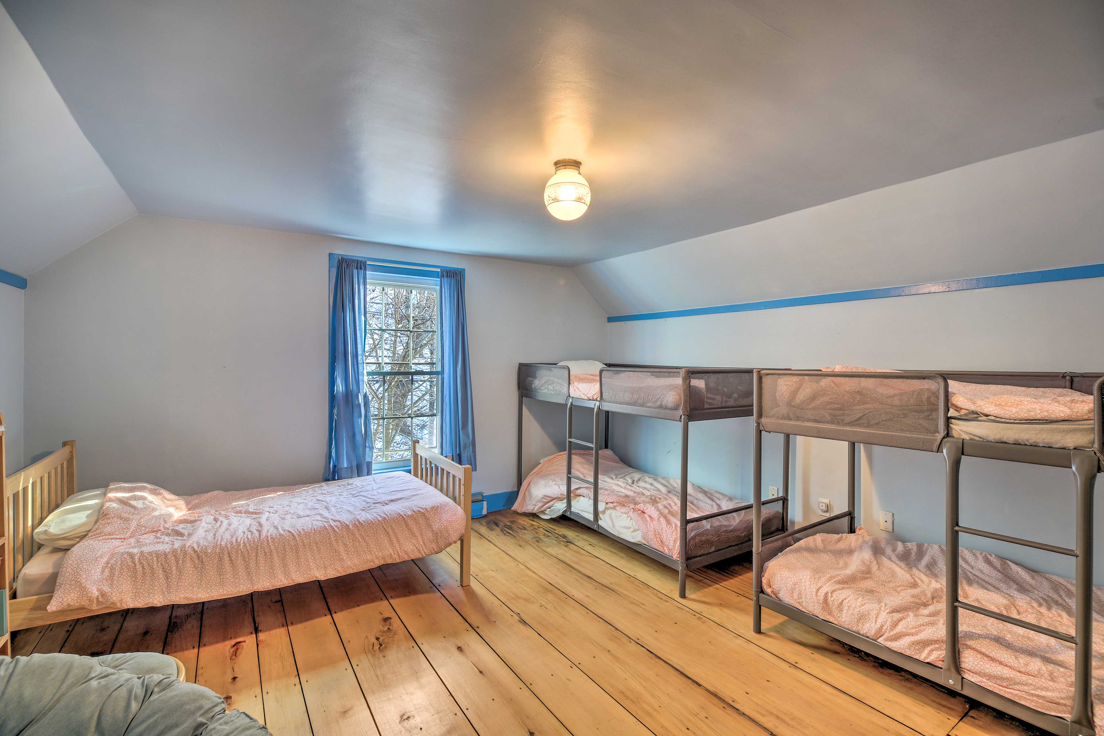 The kid's room has 2 twin bunk beds and a separate twin bed.