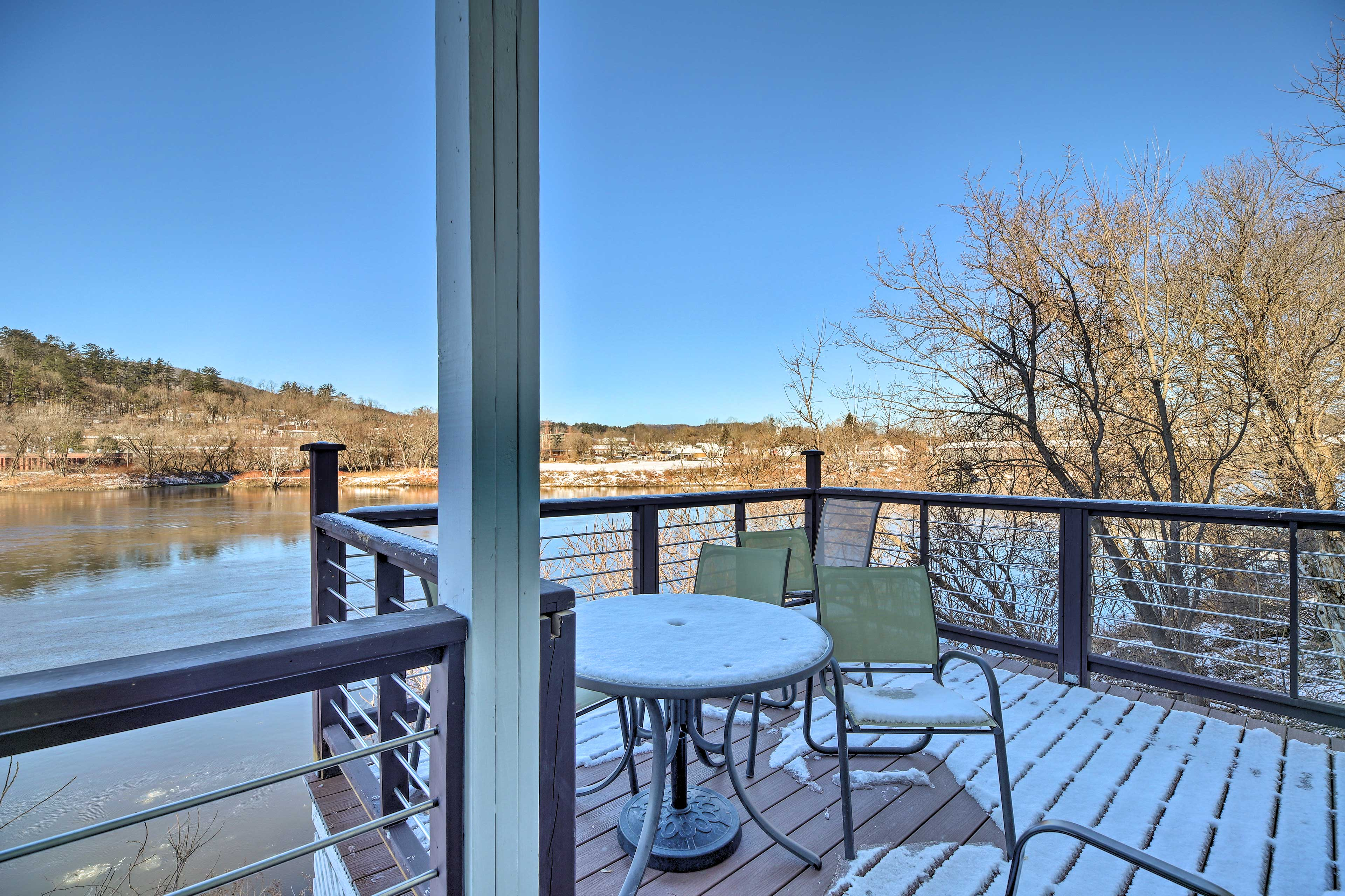 An outdoor dining area is perfect for enjoying riverside meals.