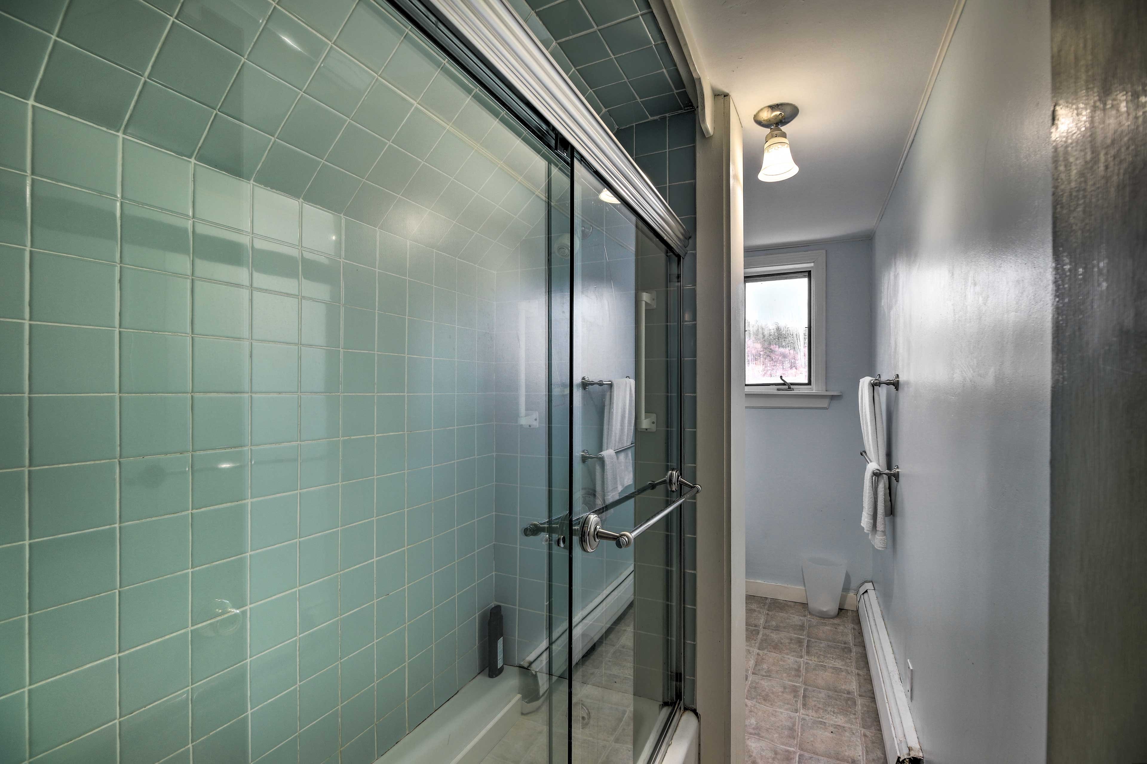 This bathroom has a large walk-in shower.