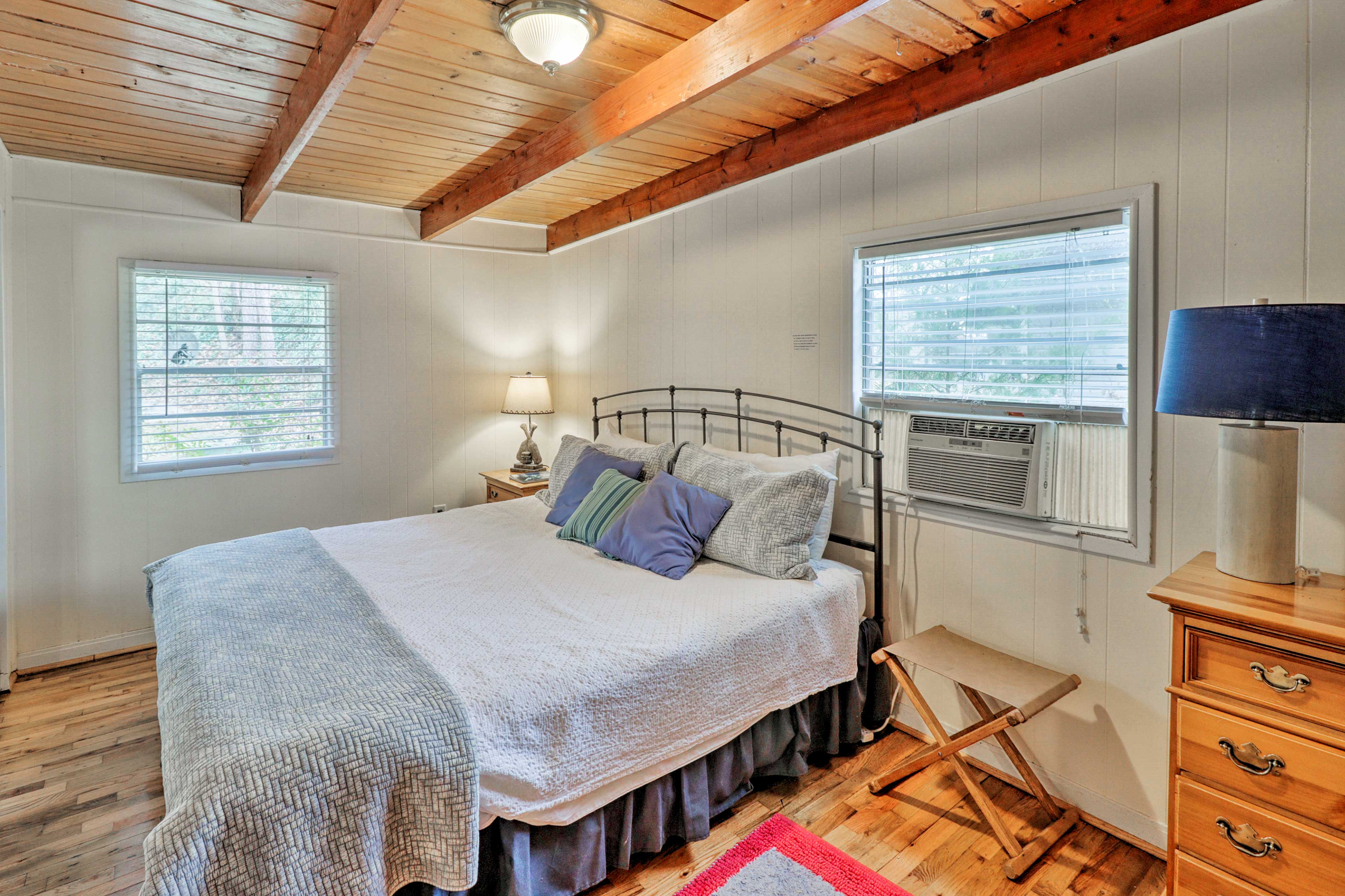 Cool off in the California king-sized bed with a window A/C unit.