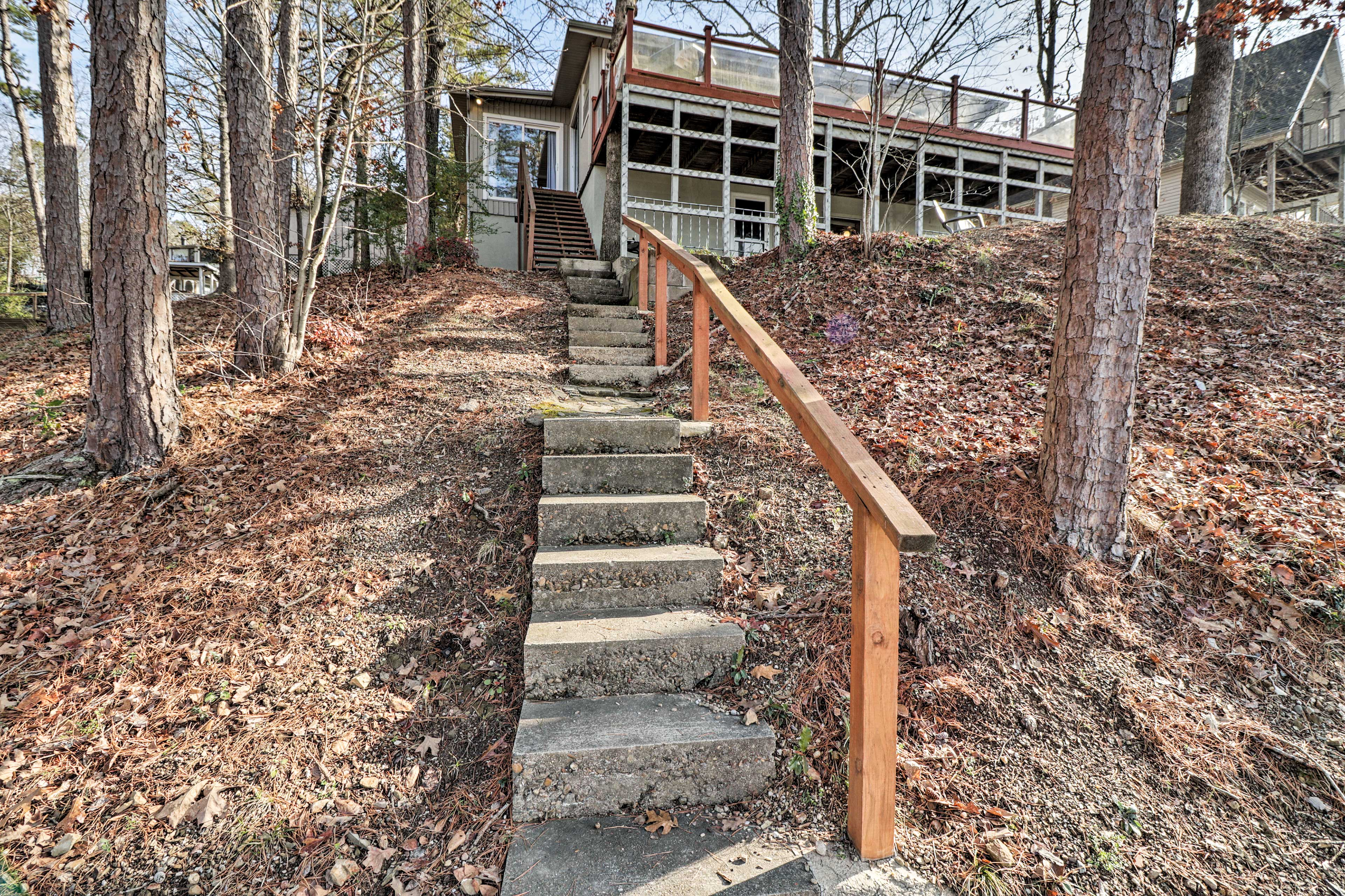 This single-story home has stairs leading down to the riverfront.