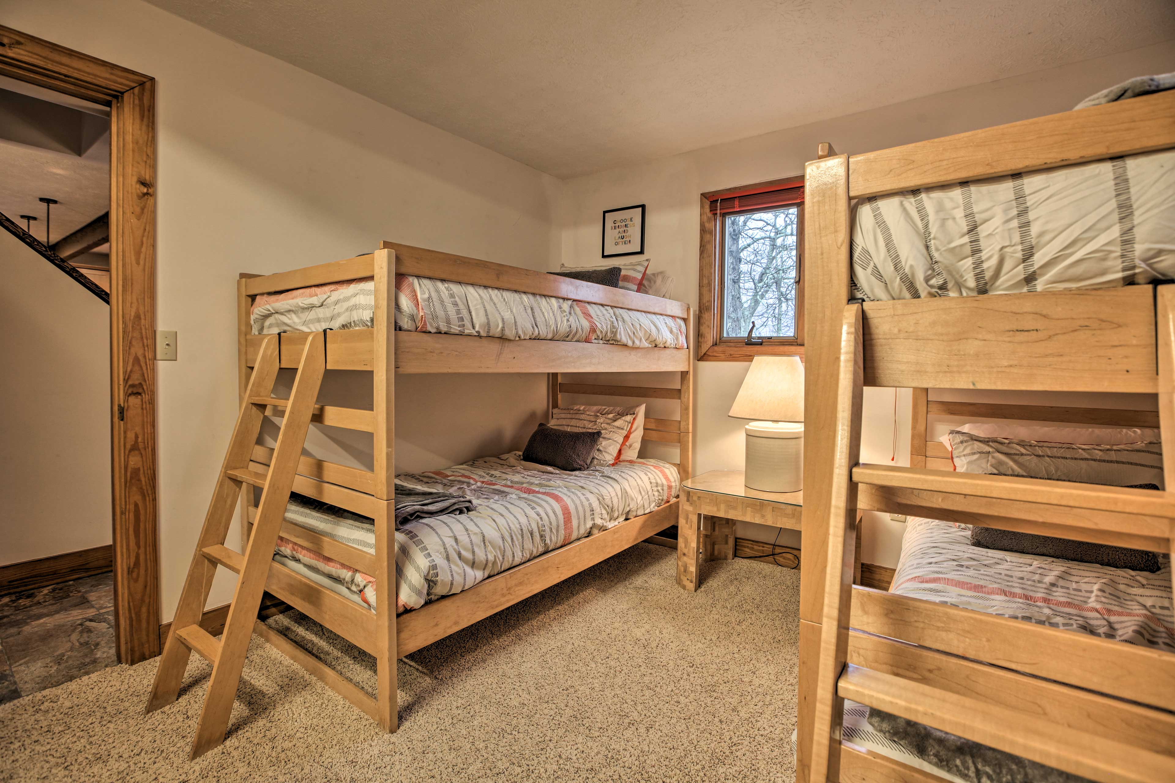 This room has 4 twin beds for up to 4 guests.