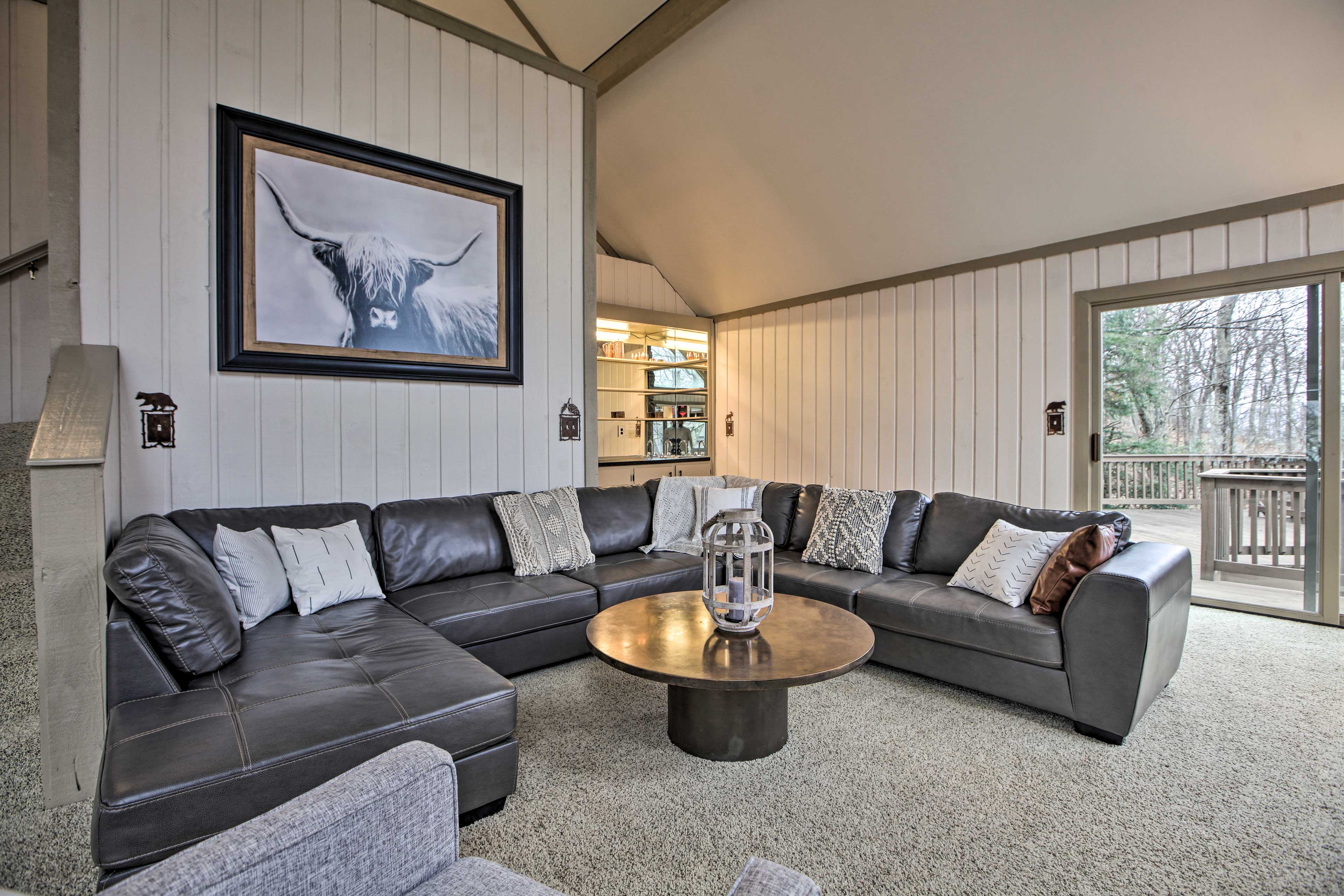 The living room has easy access to the deck.