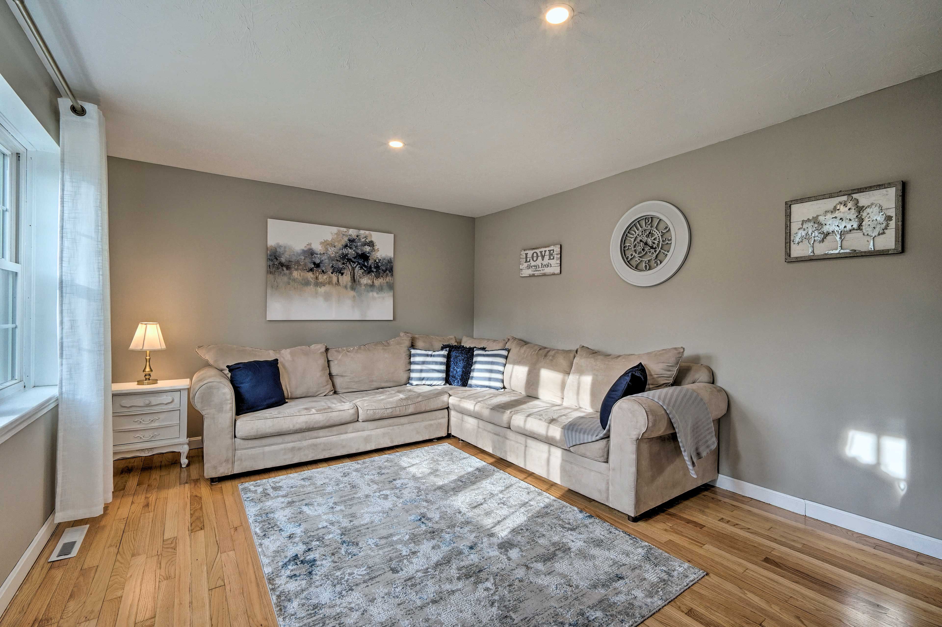 Spread out on the sectional sofa and watch a movie on the flat-screen TV!