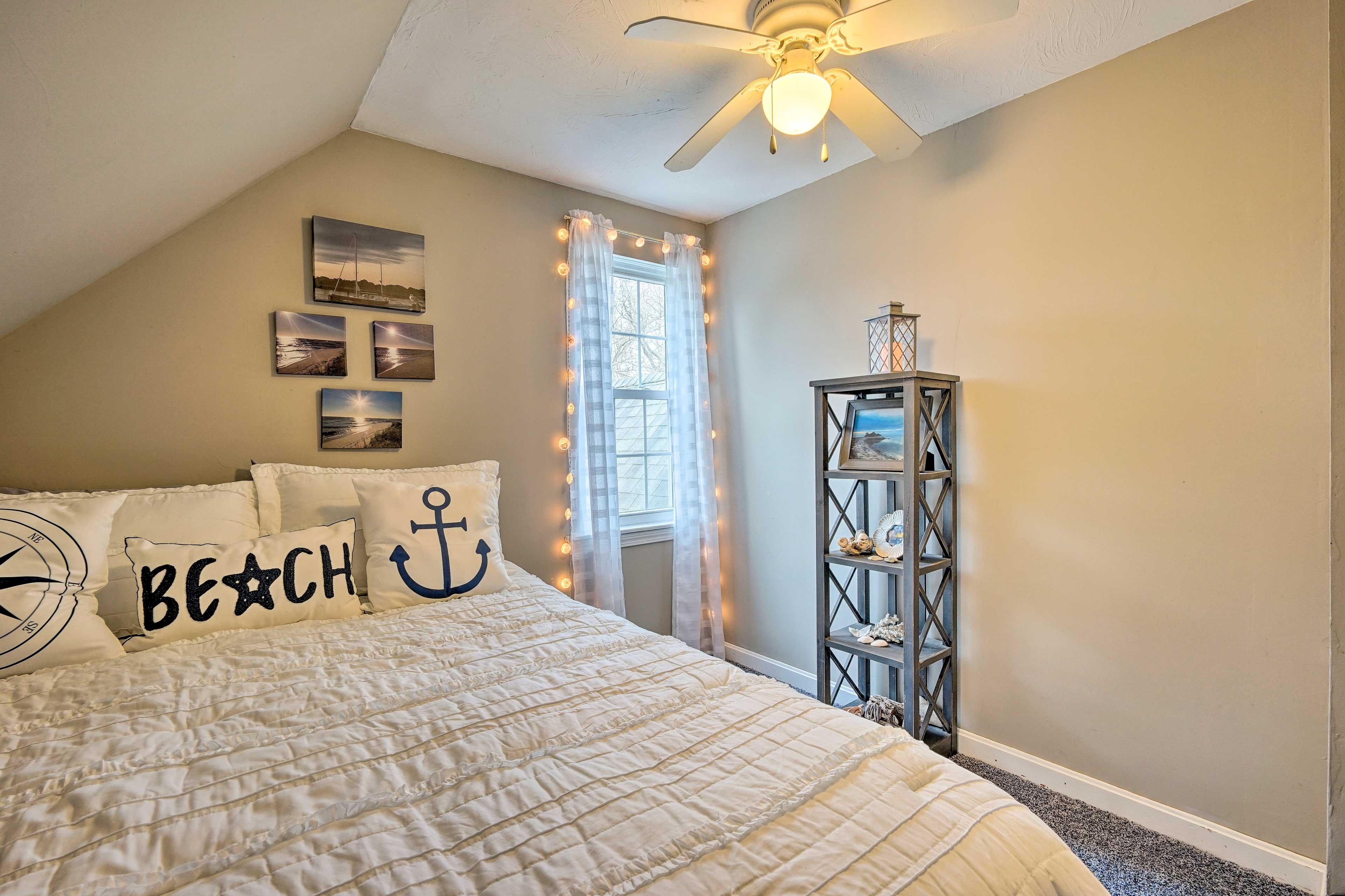 This room has tasteful beach-style decor and fairy lights!