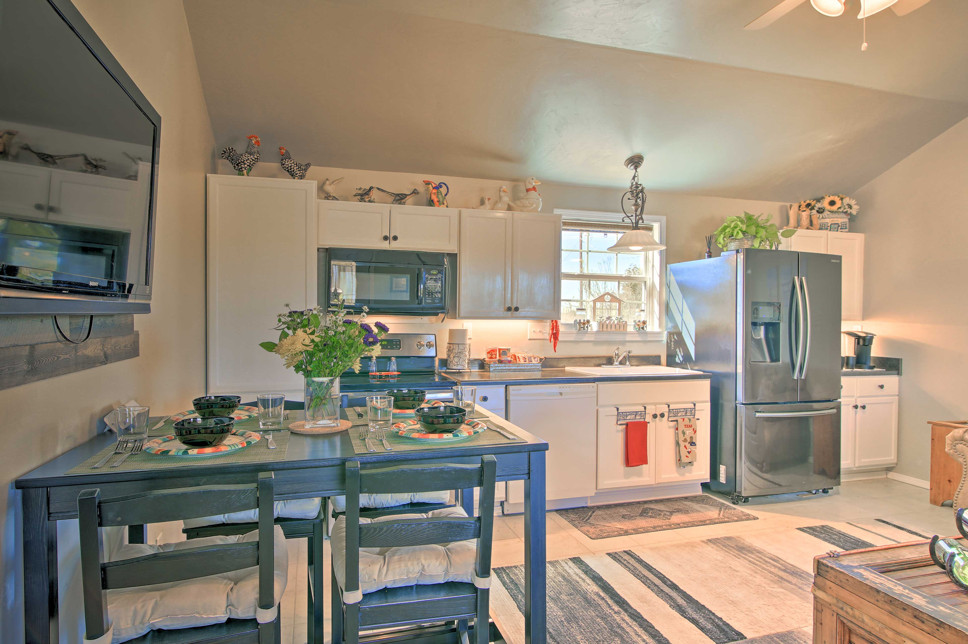 Have a sit-down dinner in the fully equipped kitchen at this vacation rental.