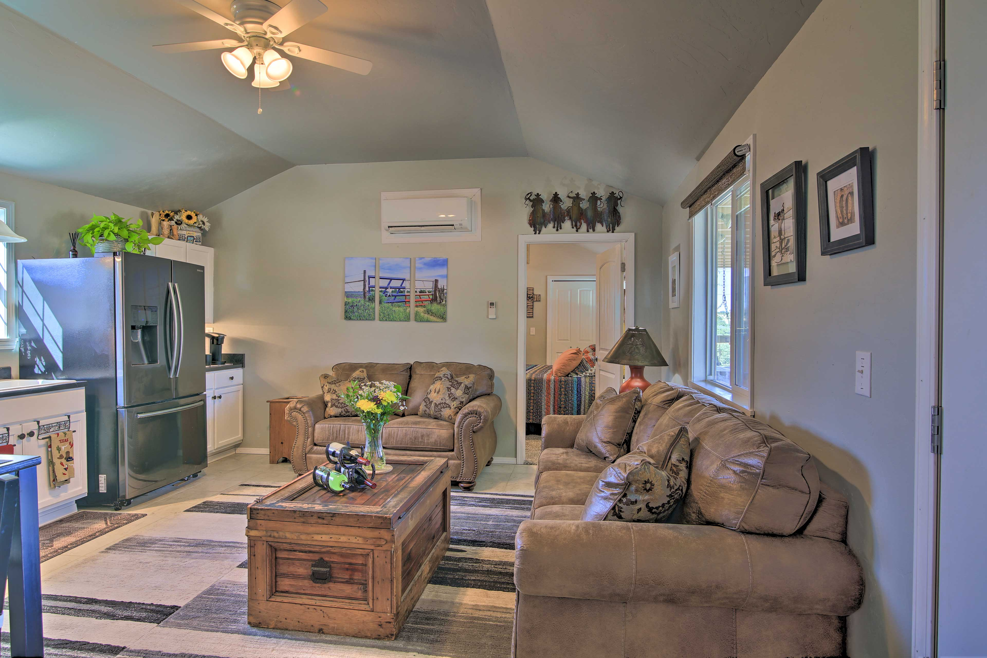 The country-style furniture gives a rustic feeling to the living room.