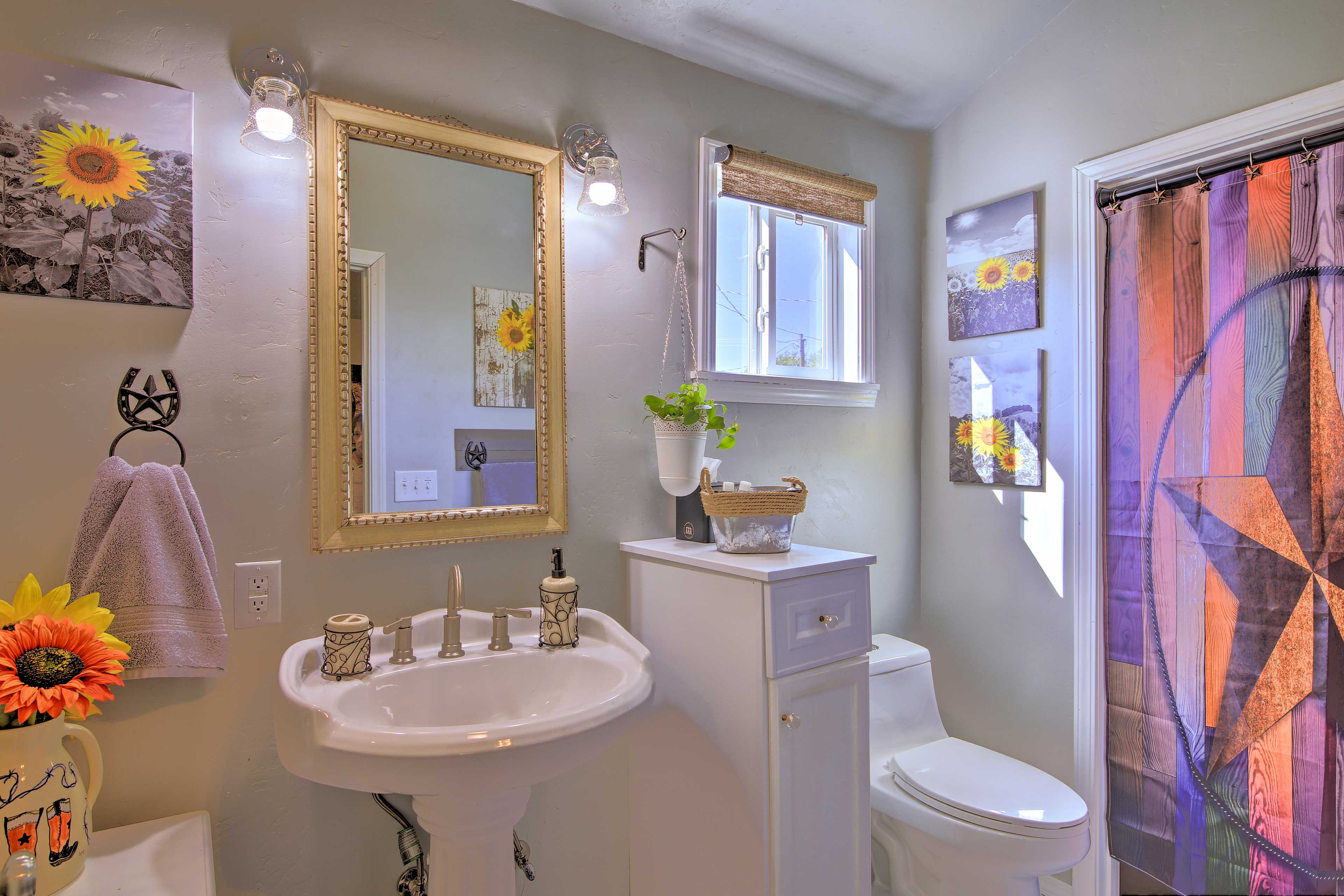 Freshen up in the second bathroom with floral decor!