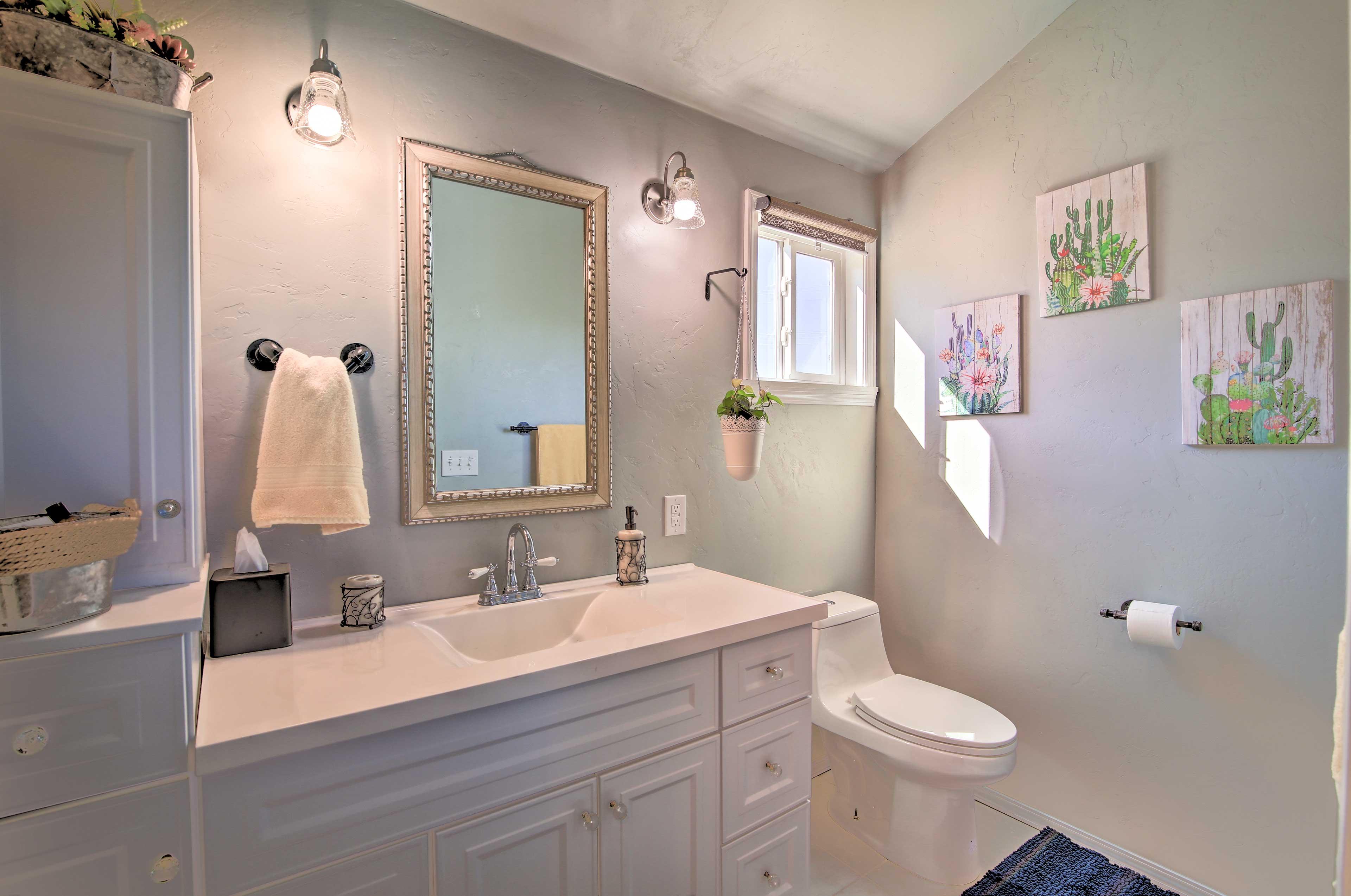 The en-suite bathroom has plenty of storage space for your toiletries.