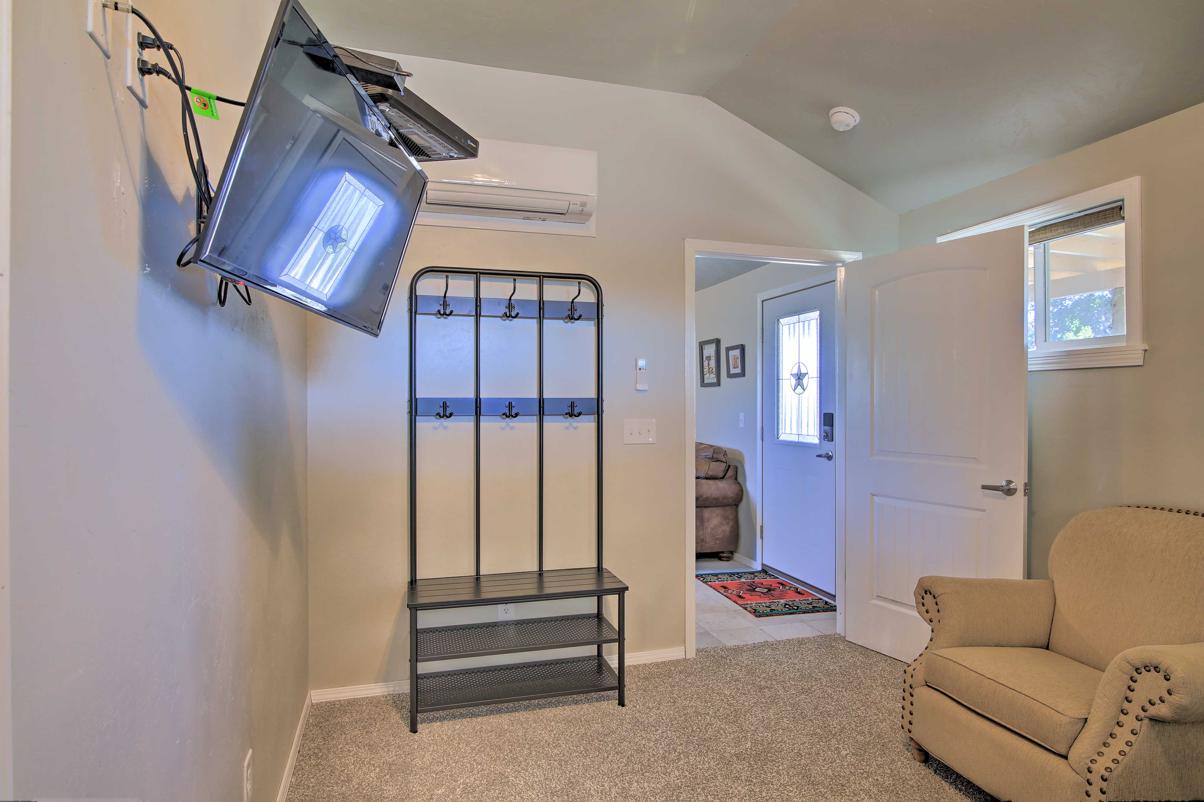 Keep your outfits stored below the remote-controlled A/C unit.