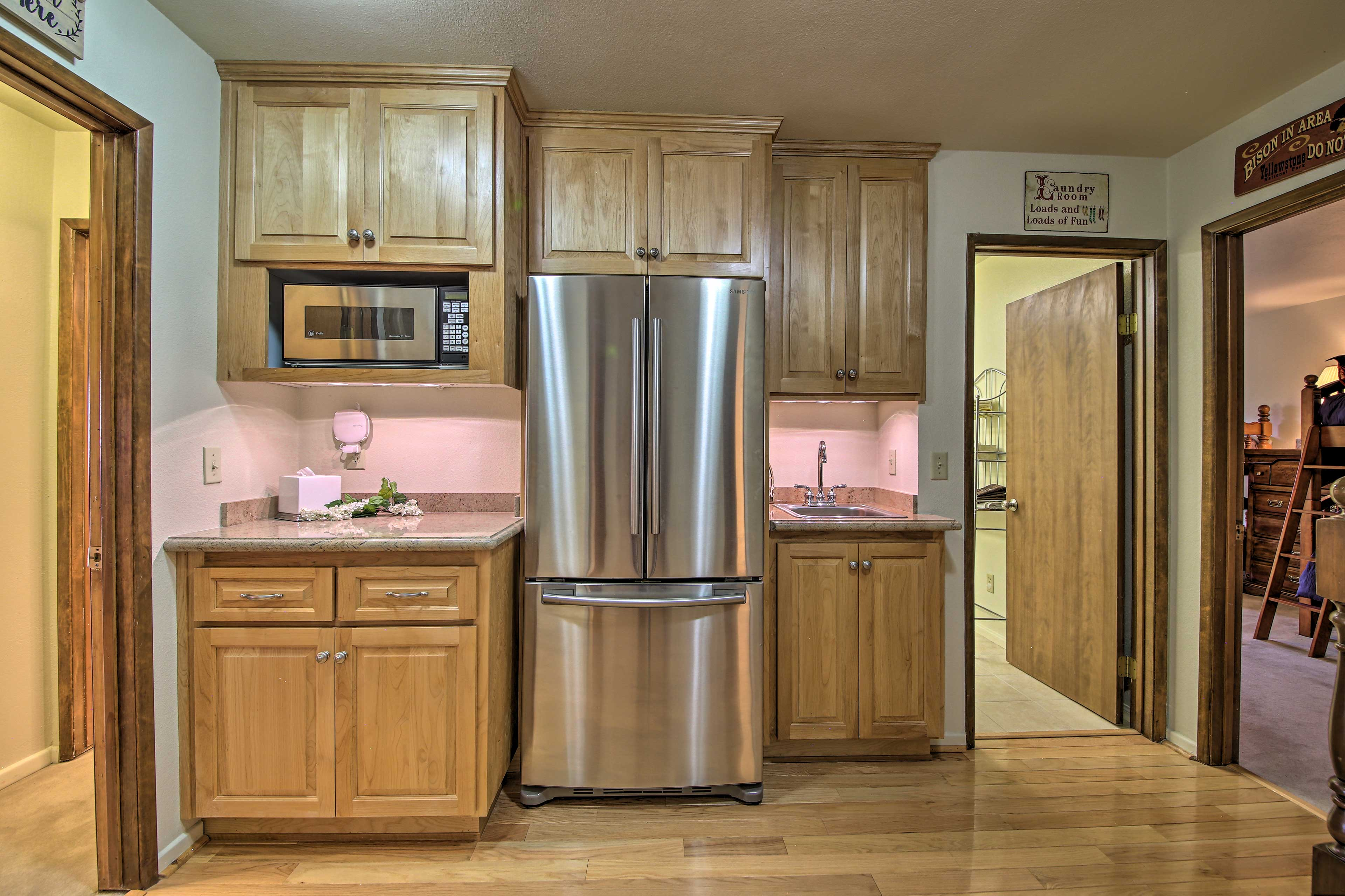 Grab a refreshing drink from the fridge in the well-equipped kitchen.