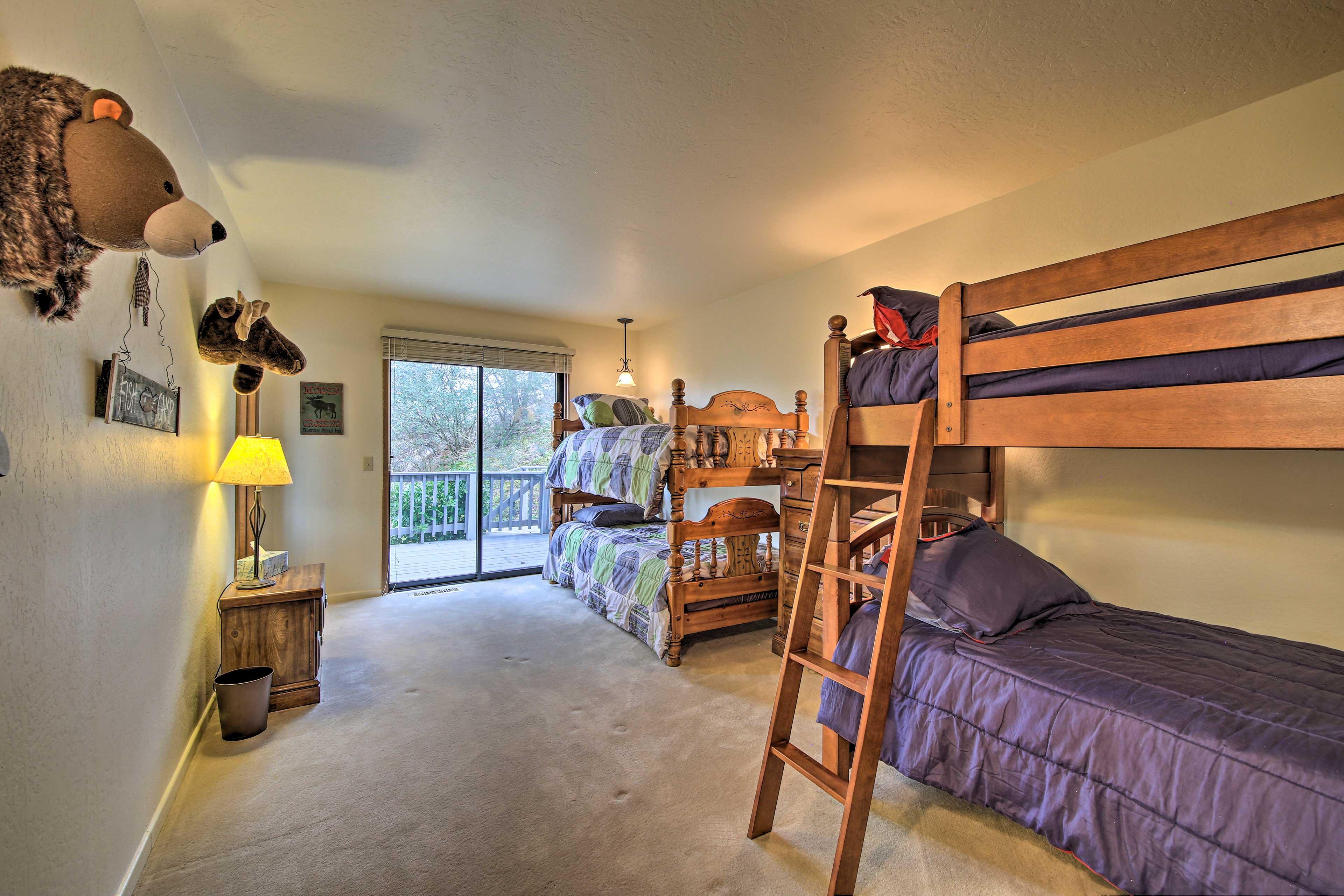 Bedroom 5 features 2 twin bunk beds.