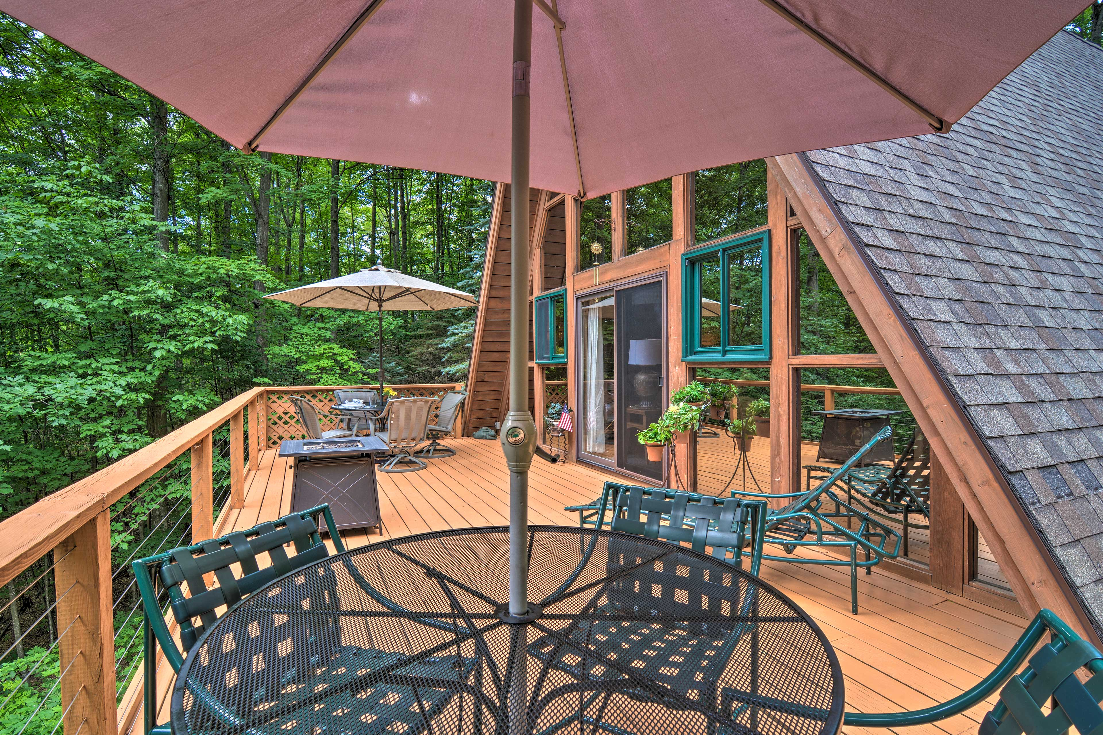 The upper-level deck features 2 dining tables in the summer.