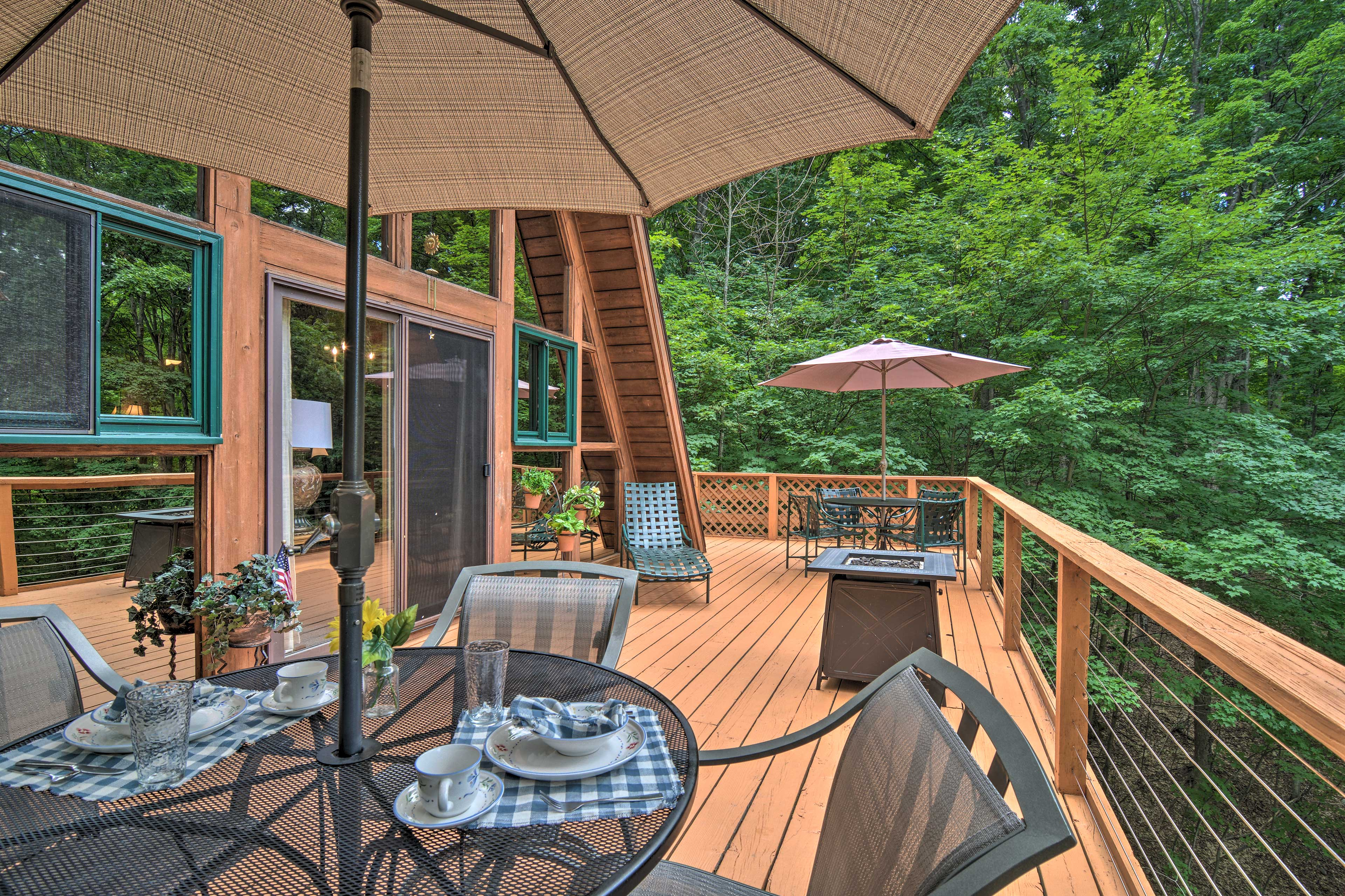 In the summer, the deck is fully furnished.