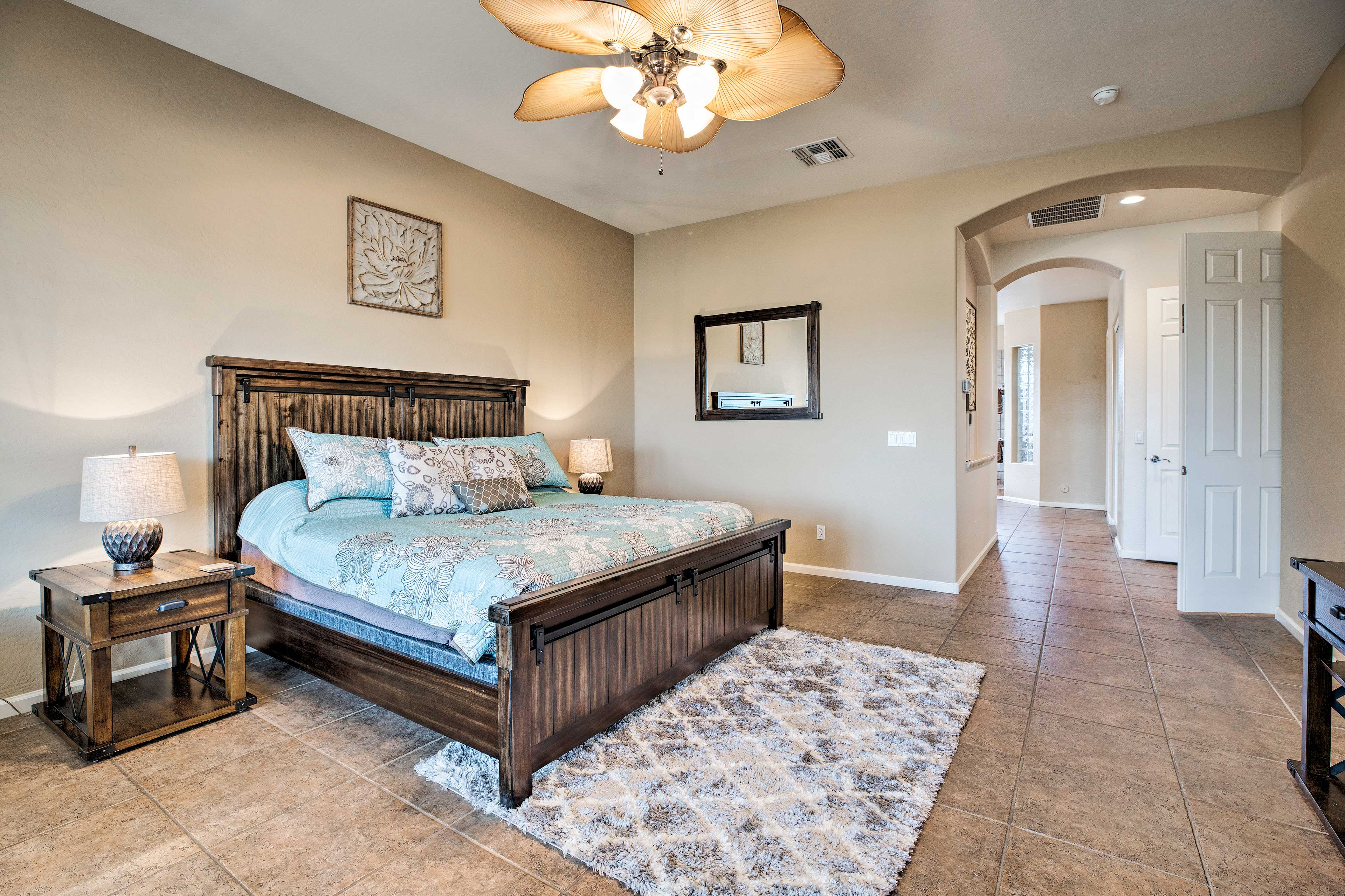 The master features private patio access, a flat screen, and an en-suite bath.