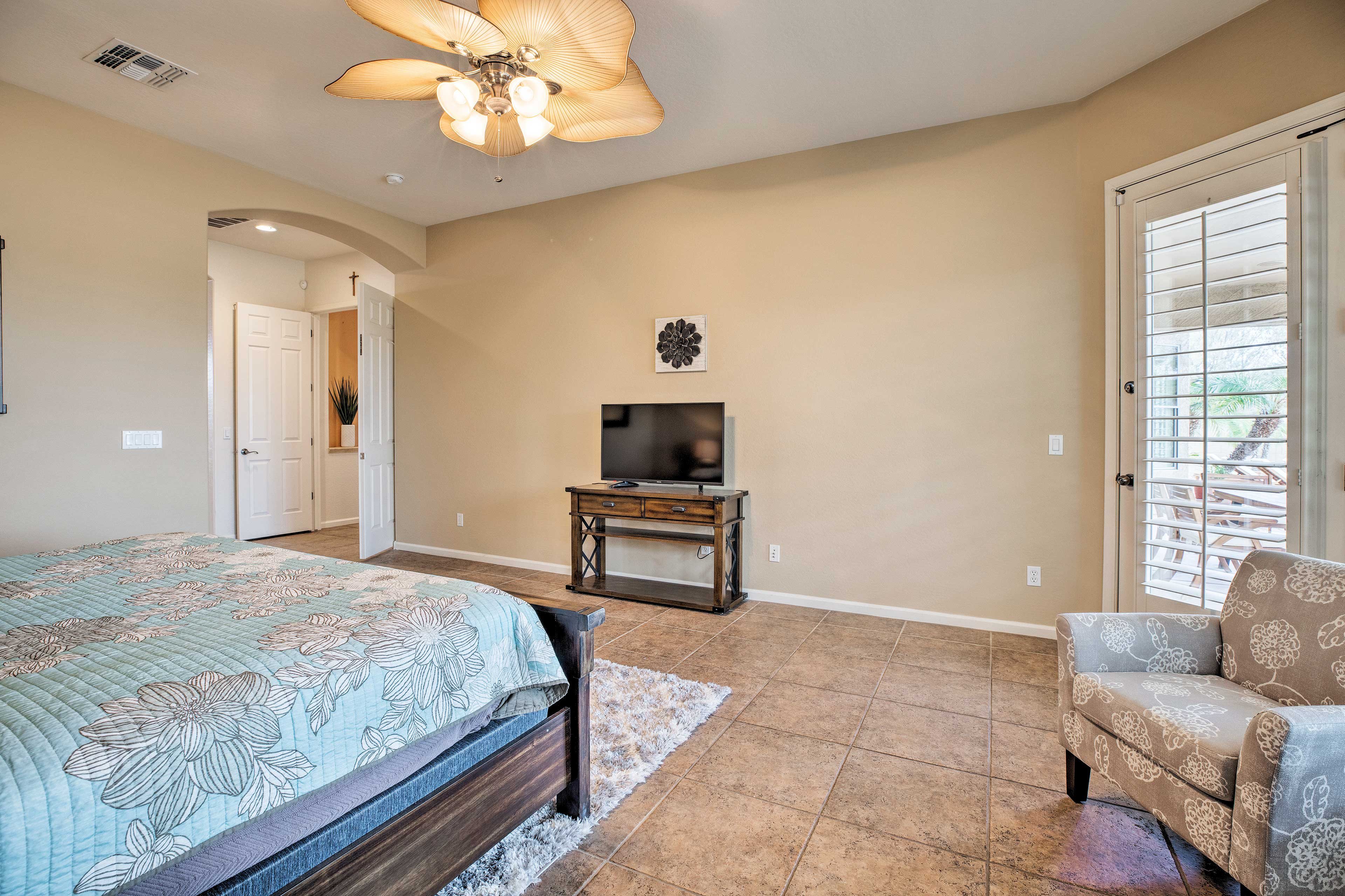 Retreat into this spacious room to watch your preferred show.