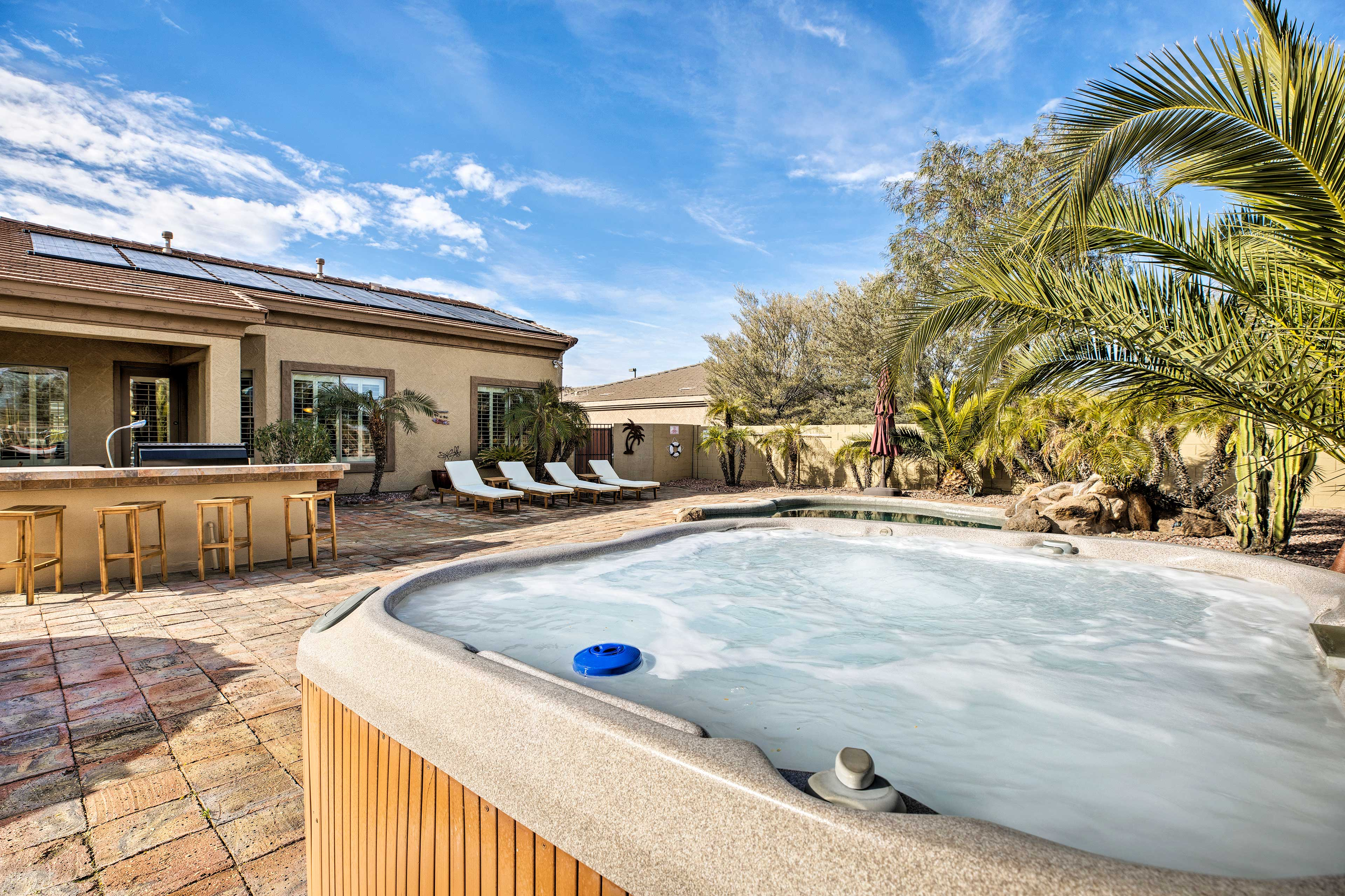 Relieve tension in the private hot tub.