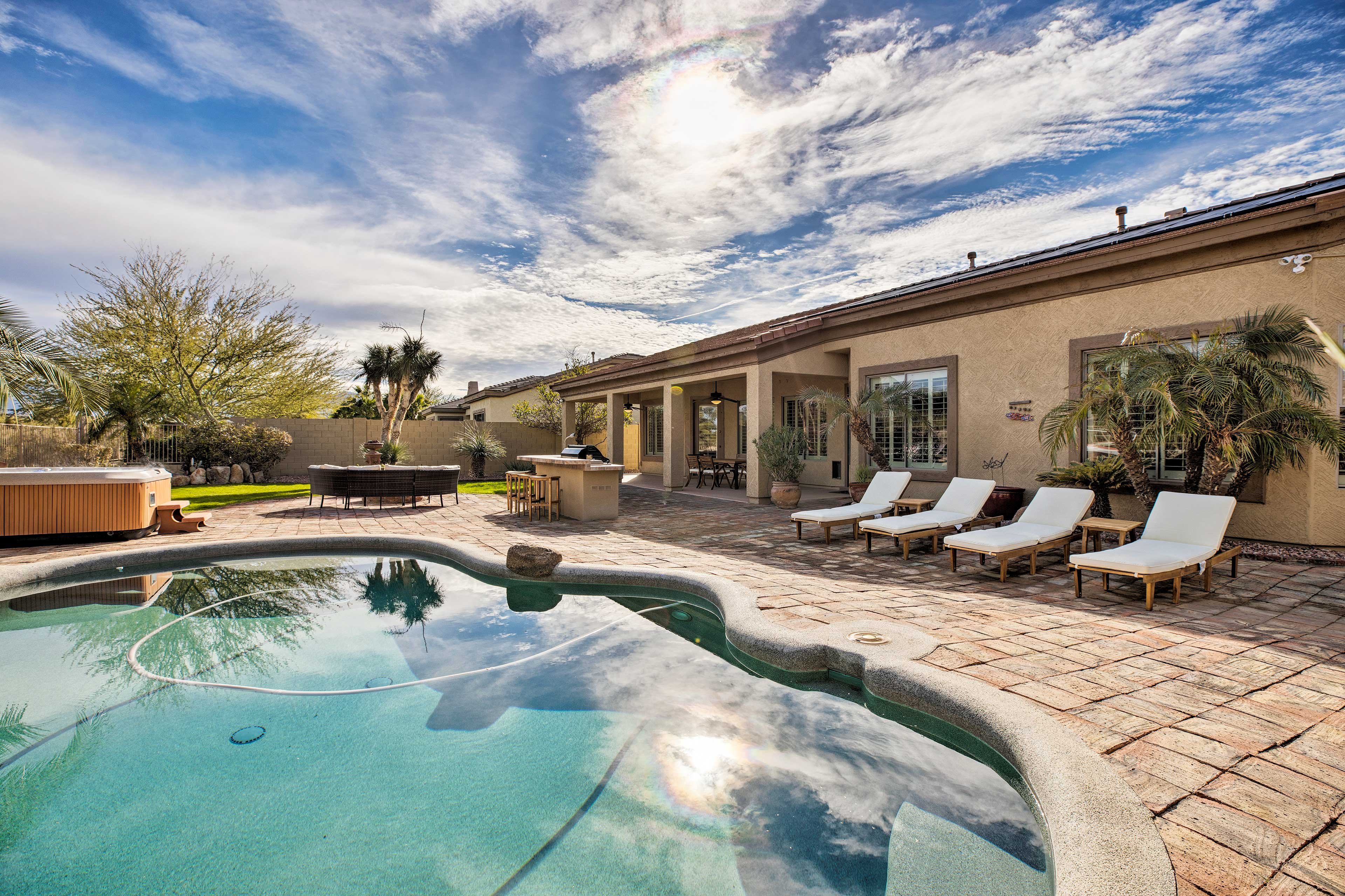 A stay at this luxe Goodyear home is a true investment in your well-being!