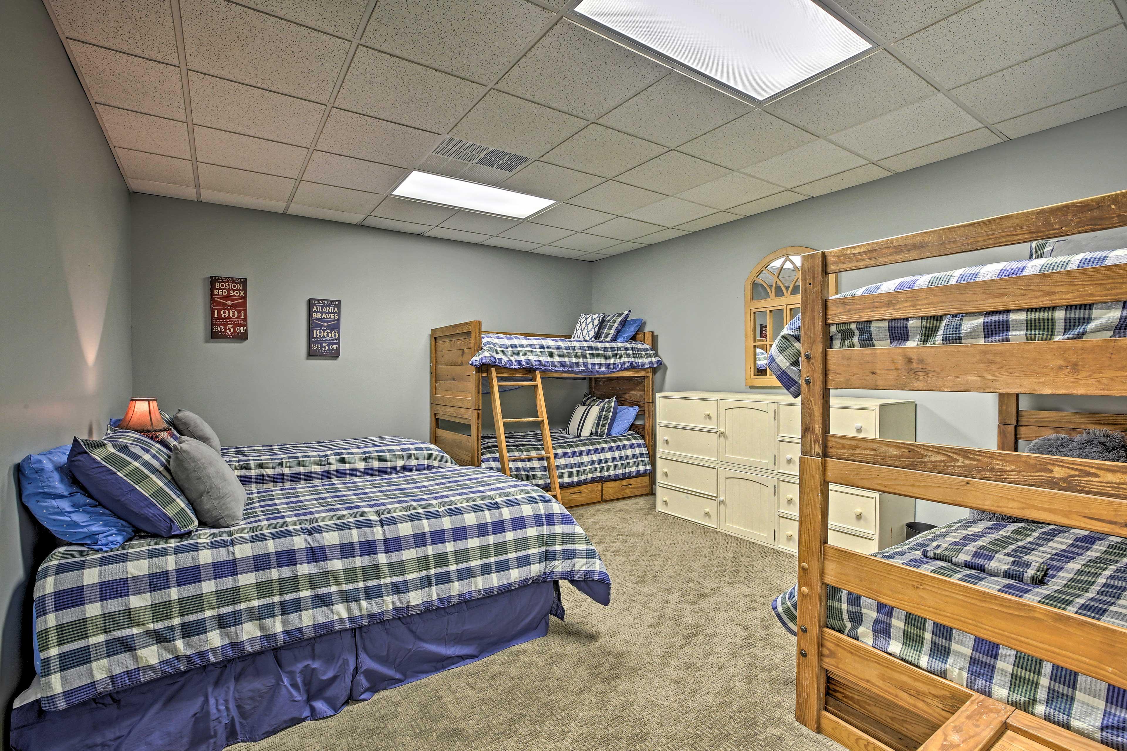 Bedroom 6 features 6 twin beds.
