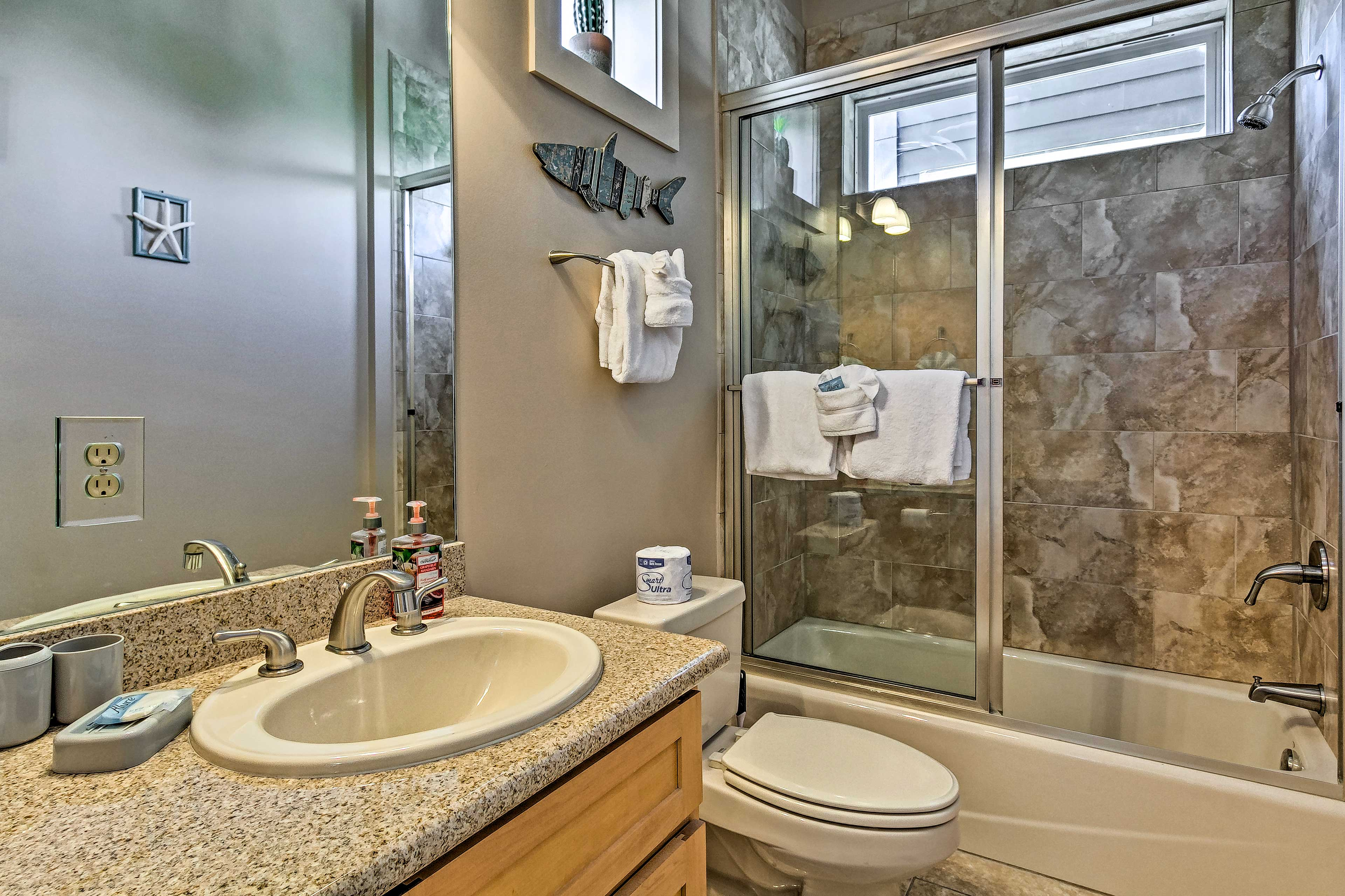 Before calling it a night, rinse off in this full en-suite bathroom.