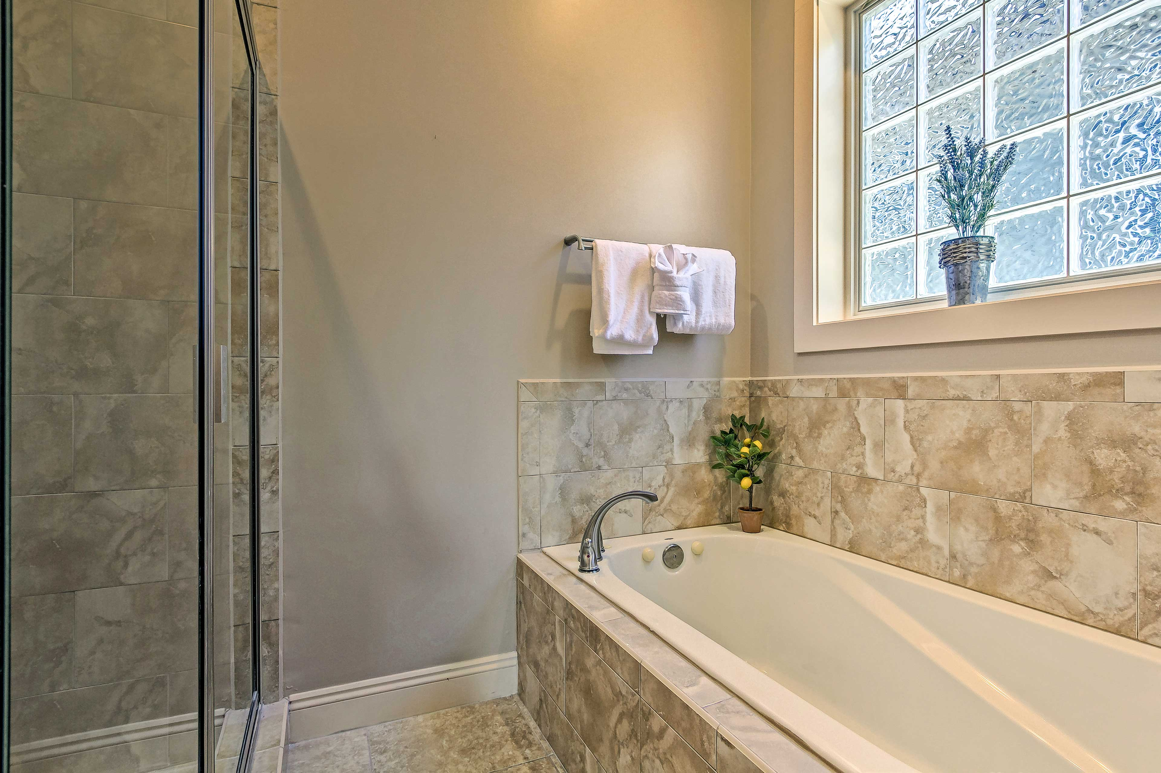 Rinse off in the walk-in shower or enjoy a soothing soak in the tub.