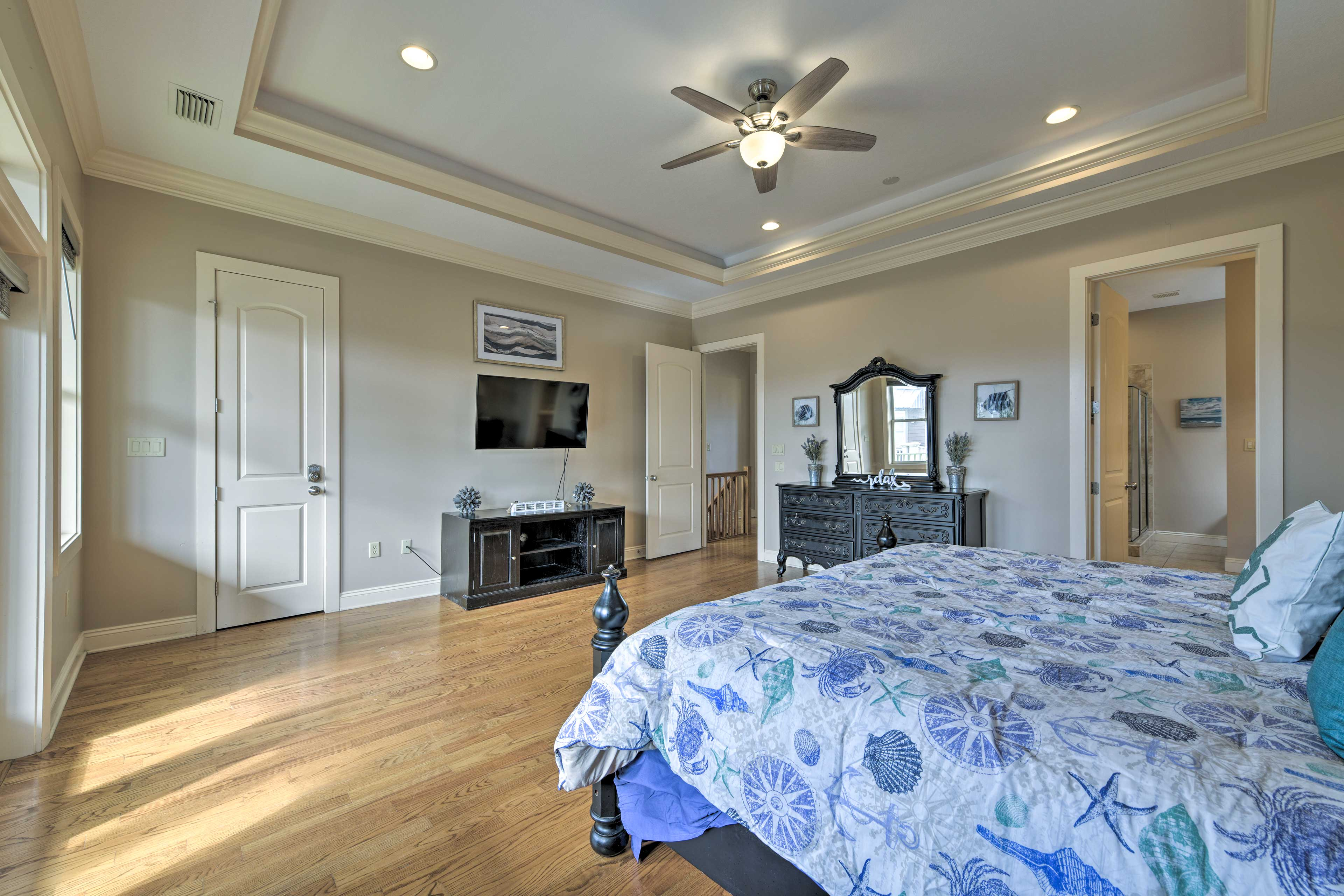 The room boasts a king bed, flat-screen TV, and private balcony.