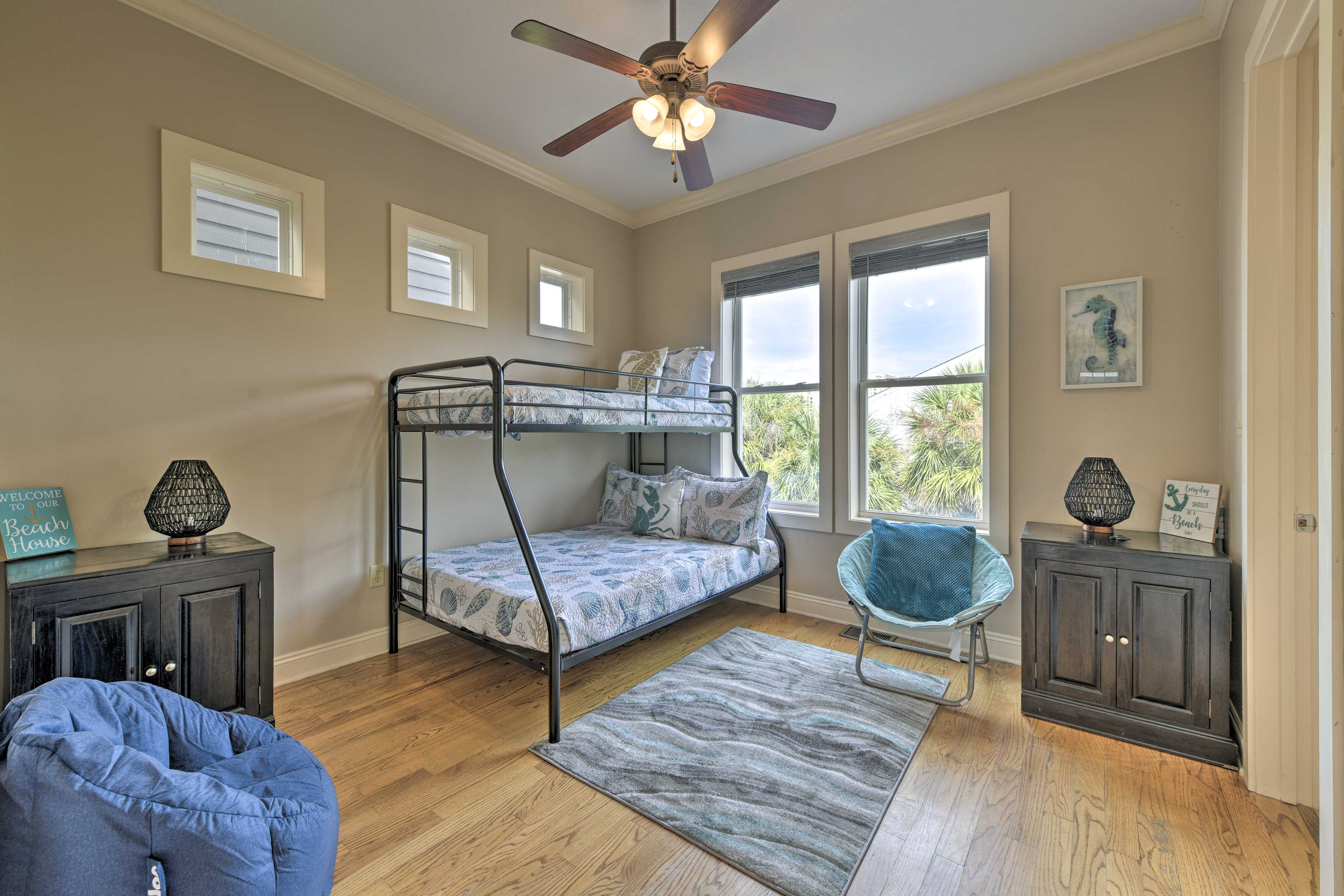 All of the bedrooms are highlighted by beach-themed decor.