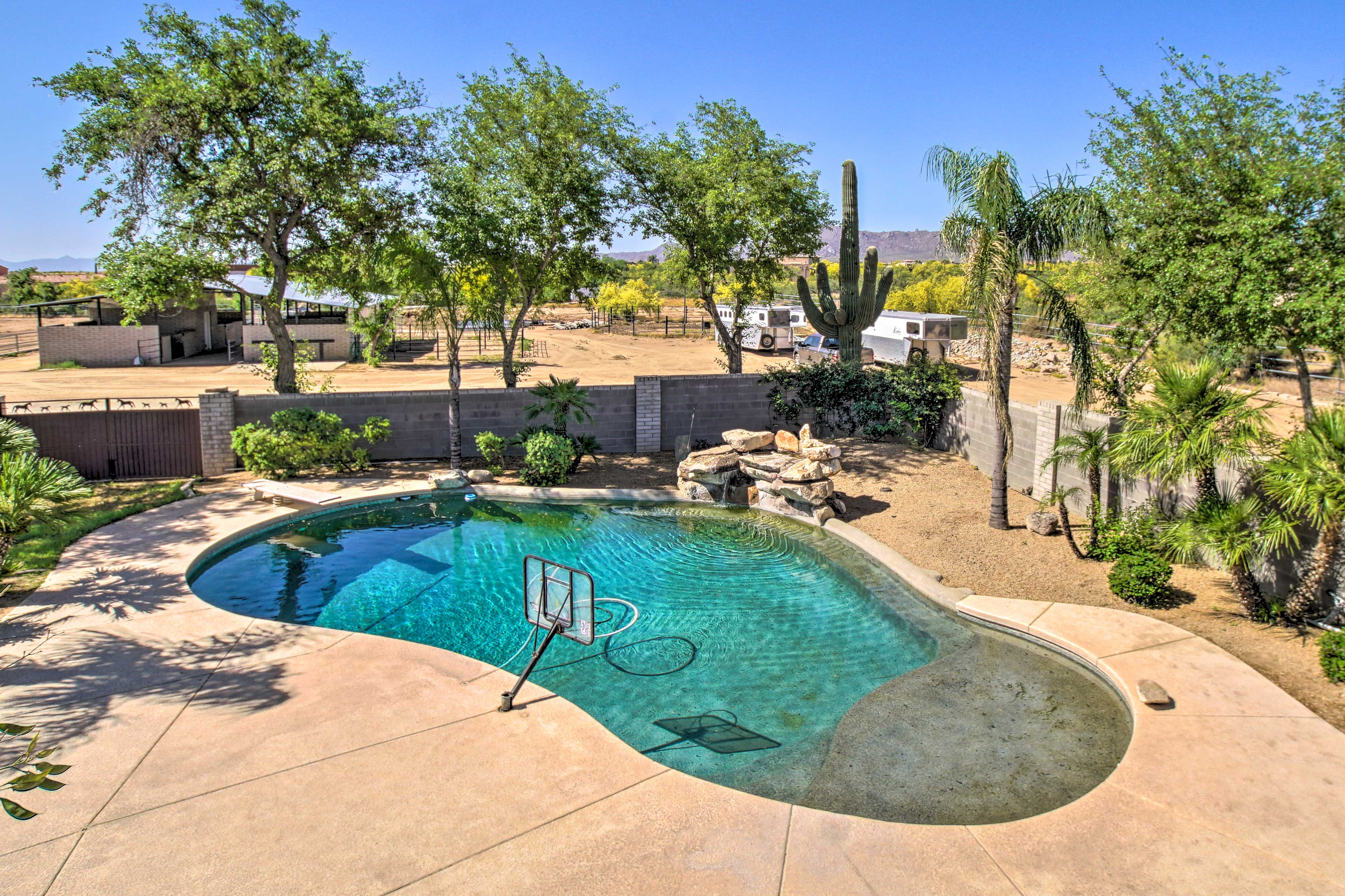 The pool is accented by the rock features and cacti.