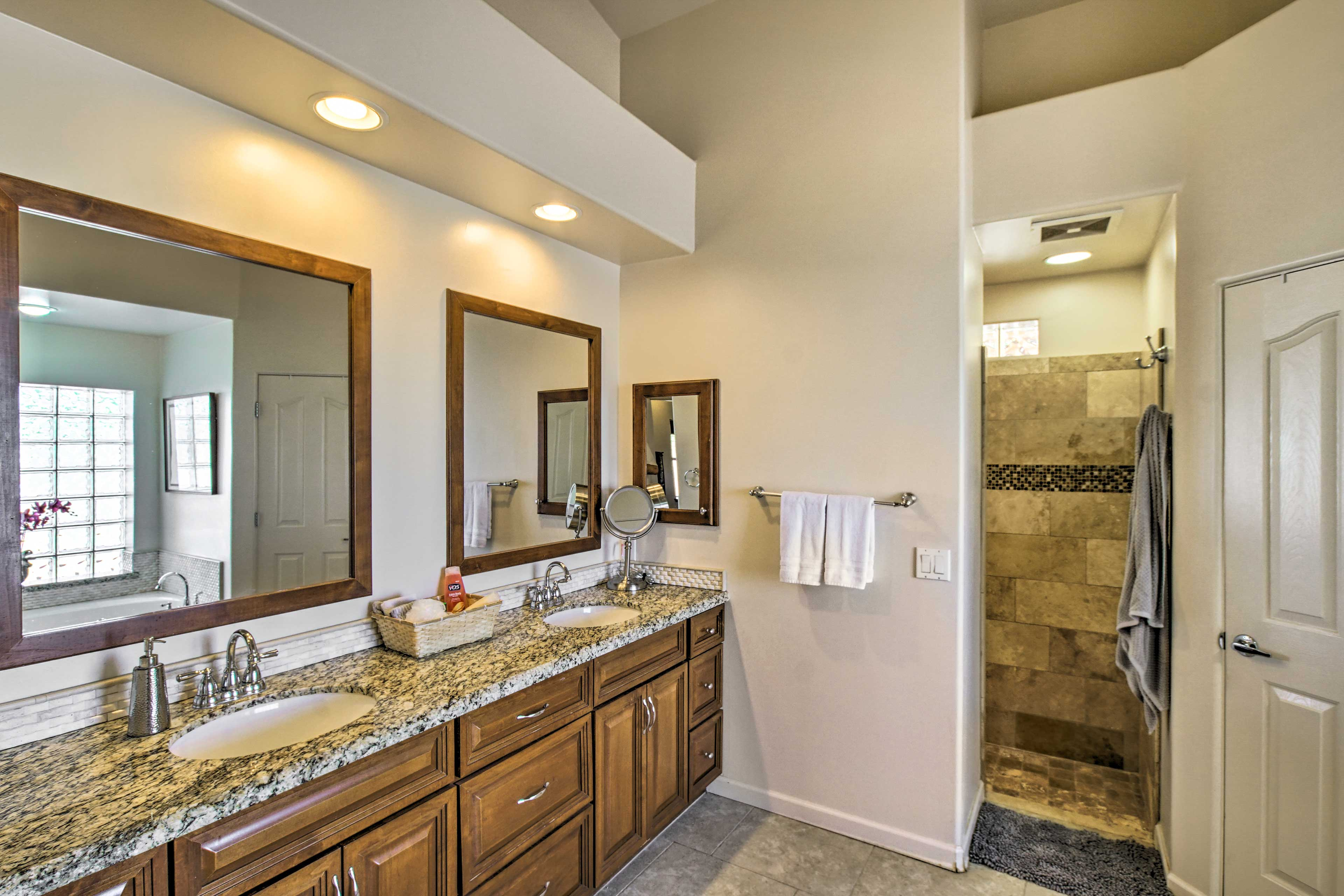 The master bathroom offers dual sinks and a walk-in shower.
