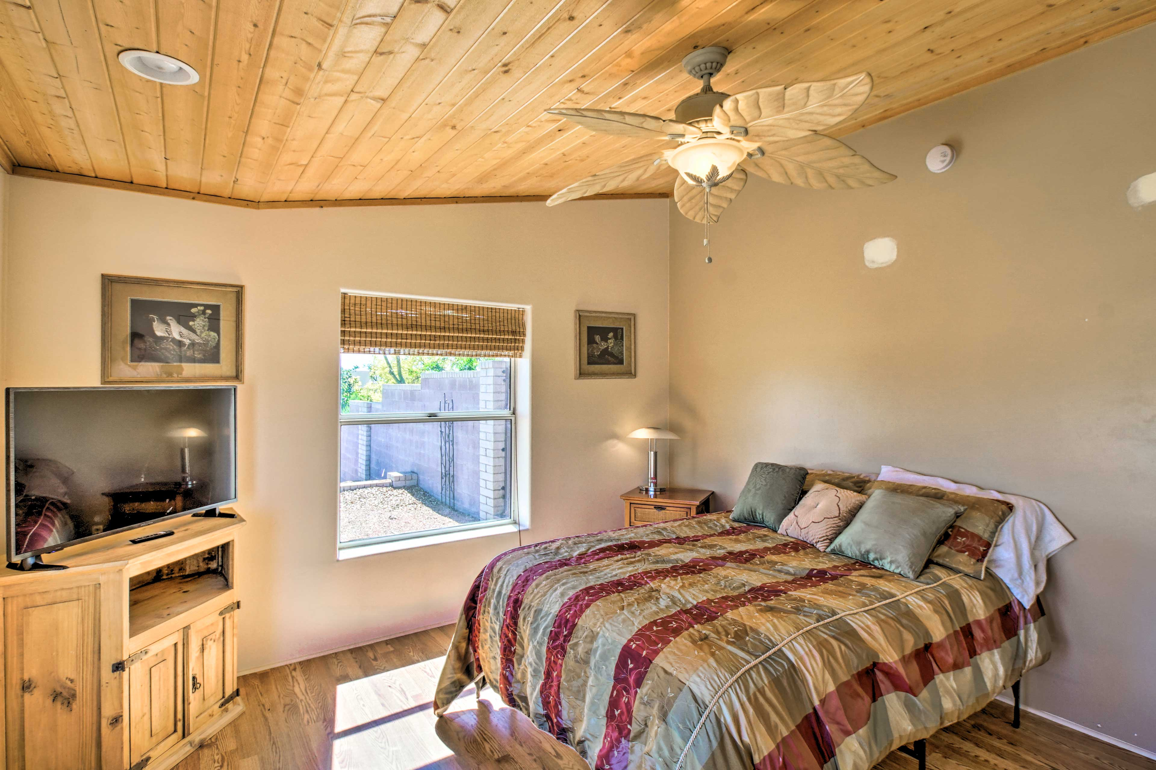 You'll find a queen bed and flat-screen TV in this second bedroom.