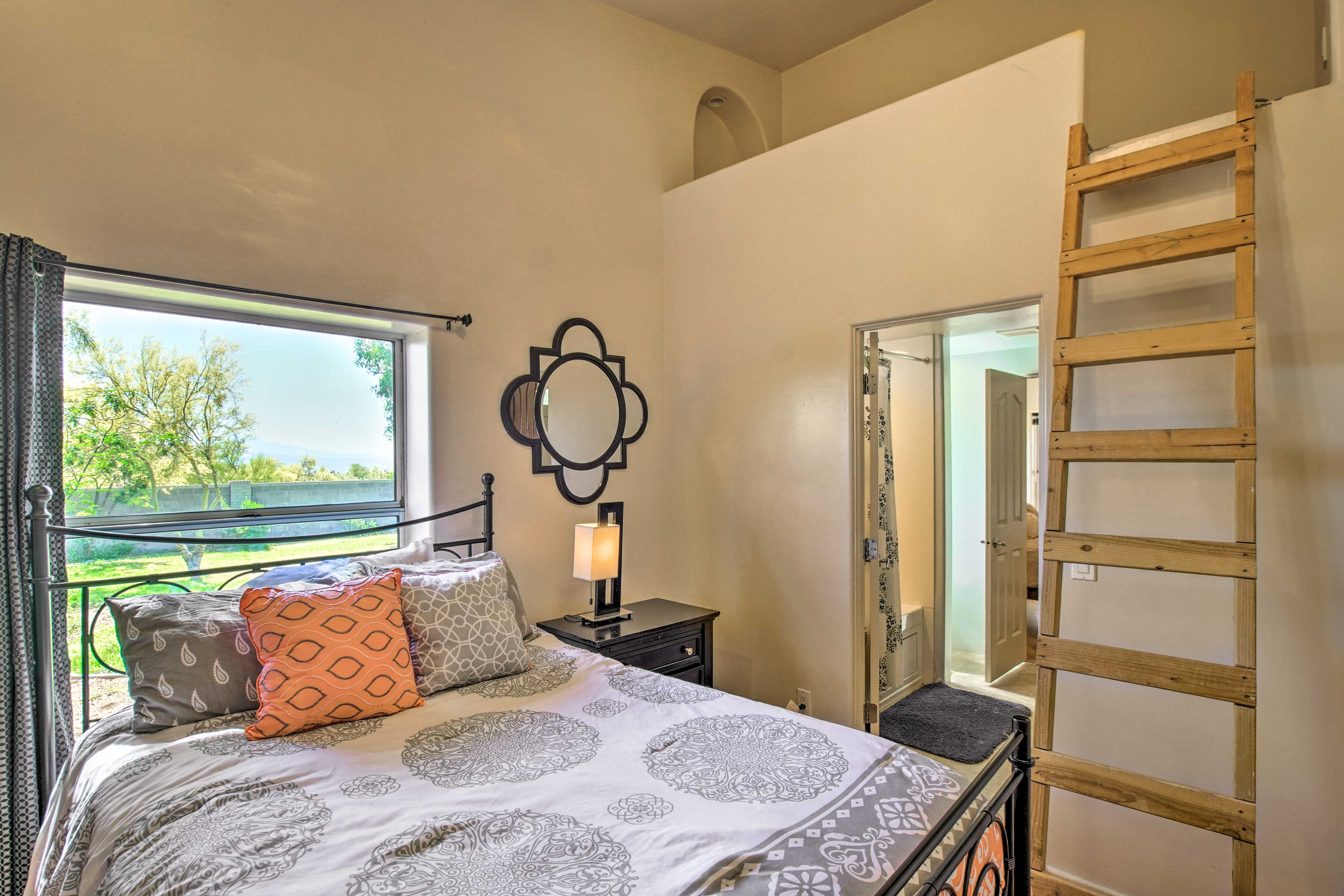 Kids will love the hidden crawl space in this bedroom.