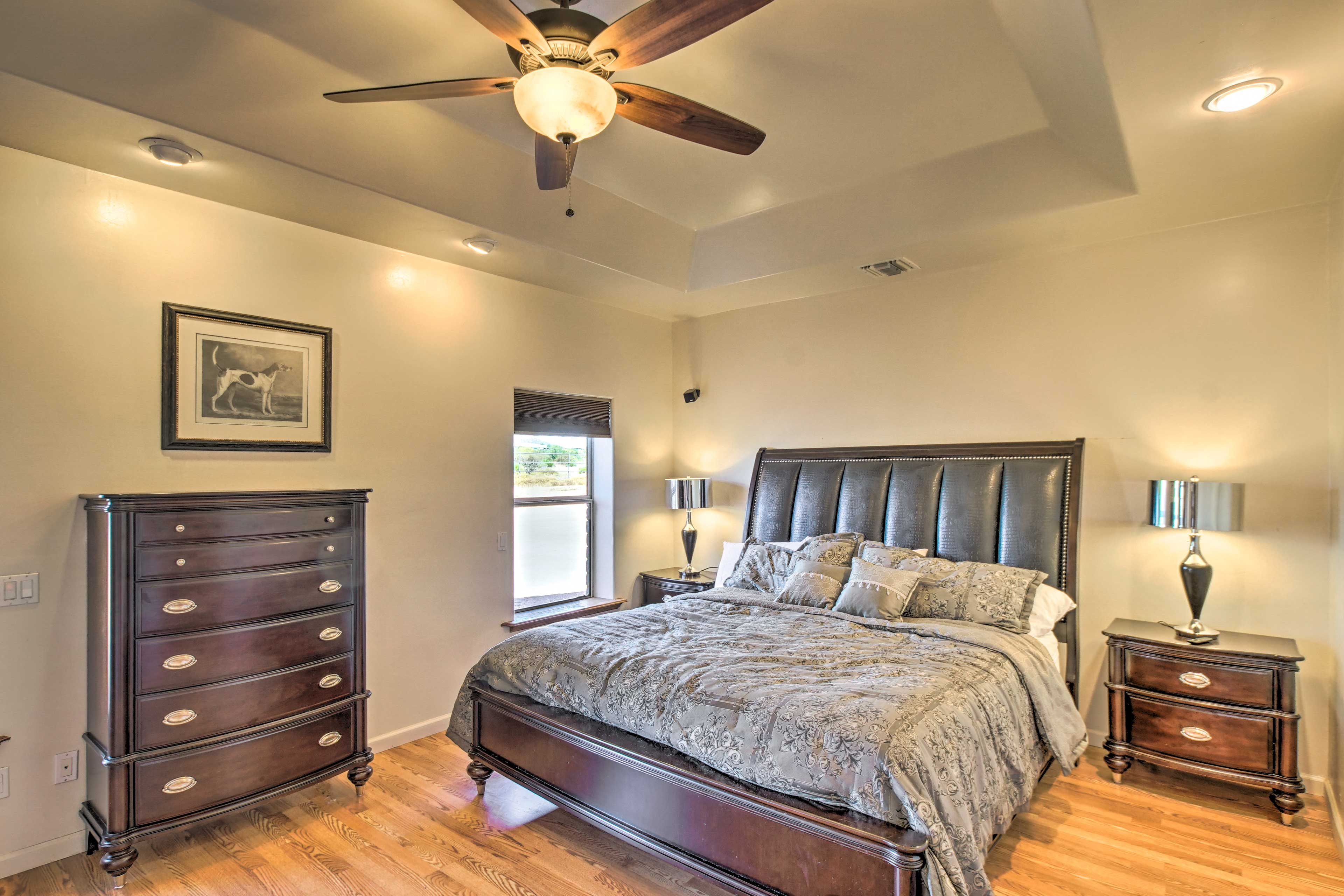 This master bedroom features a lovely king bed.