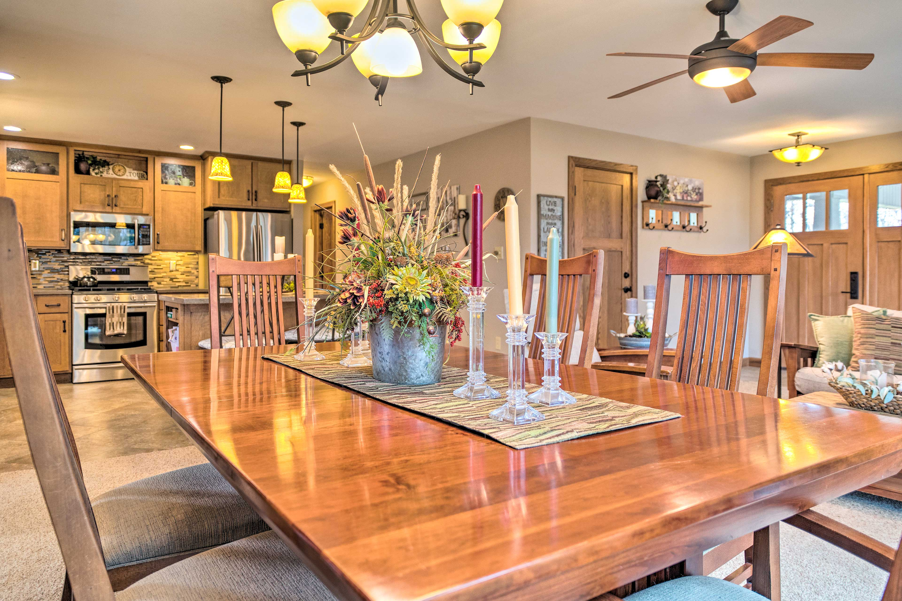 Set the wooden dining table for dinner.