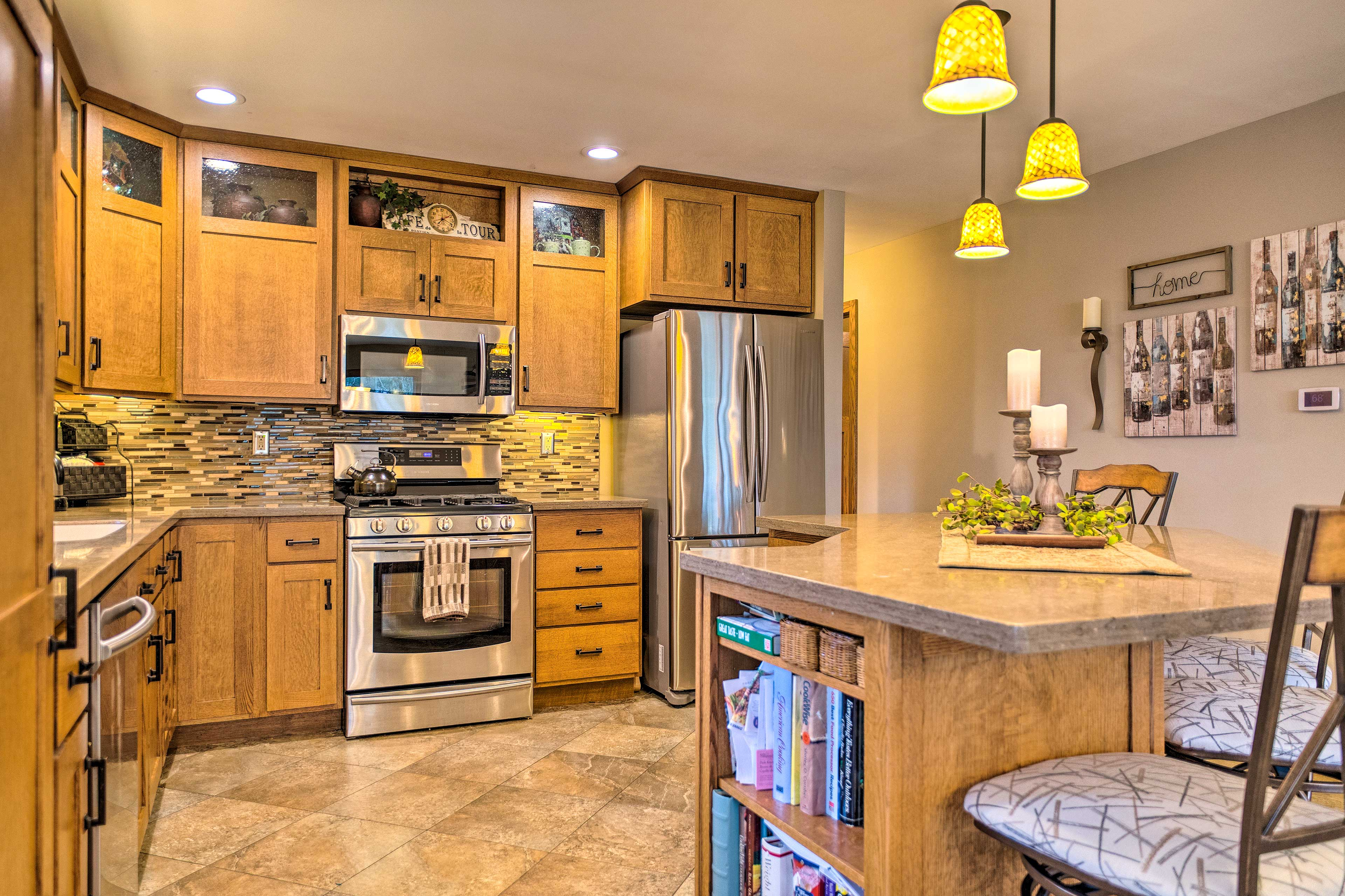 Stainless steel appliances add a modern touch to the fully equipped kitchen.