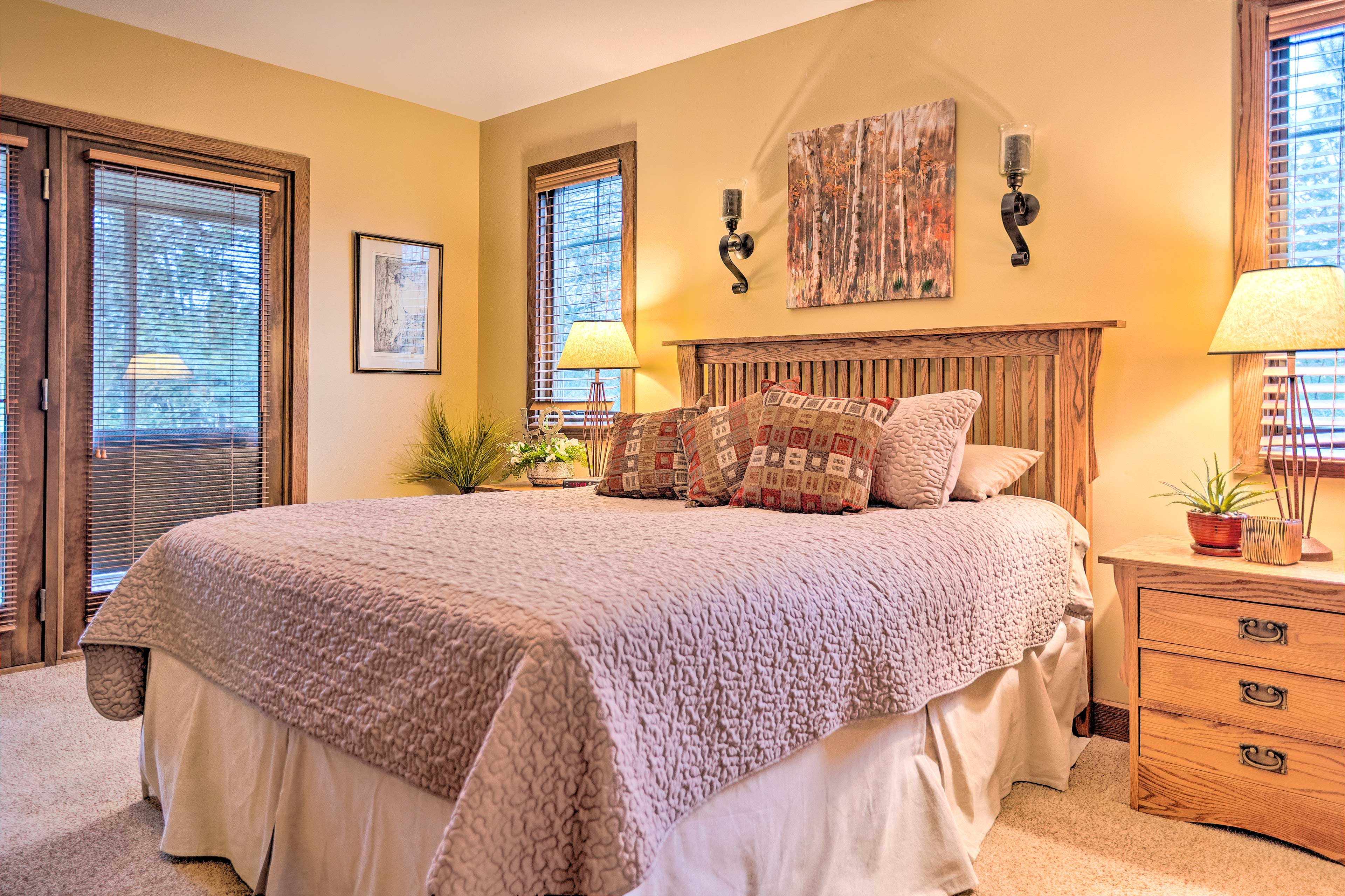 The master bedroom features a queen-sized bed.