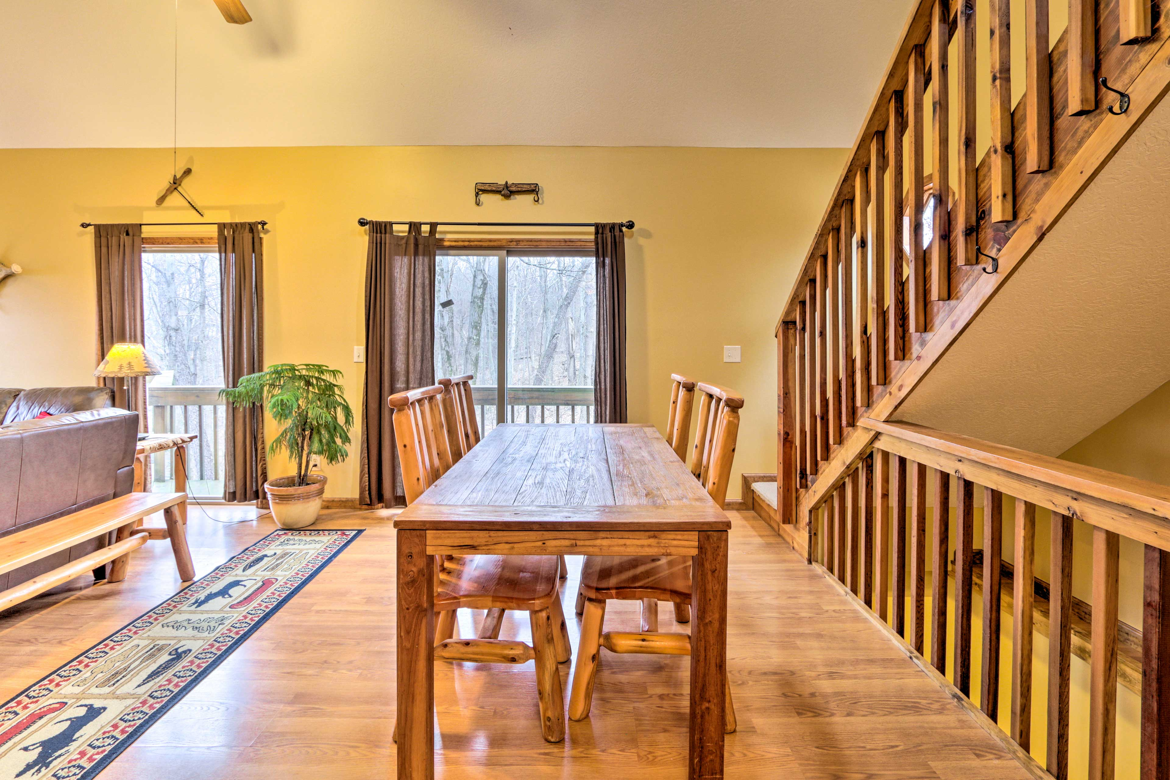 Enjoy a meal at the hardwood dining table