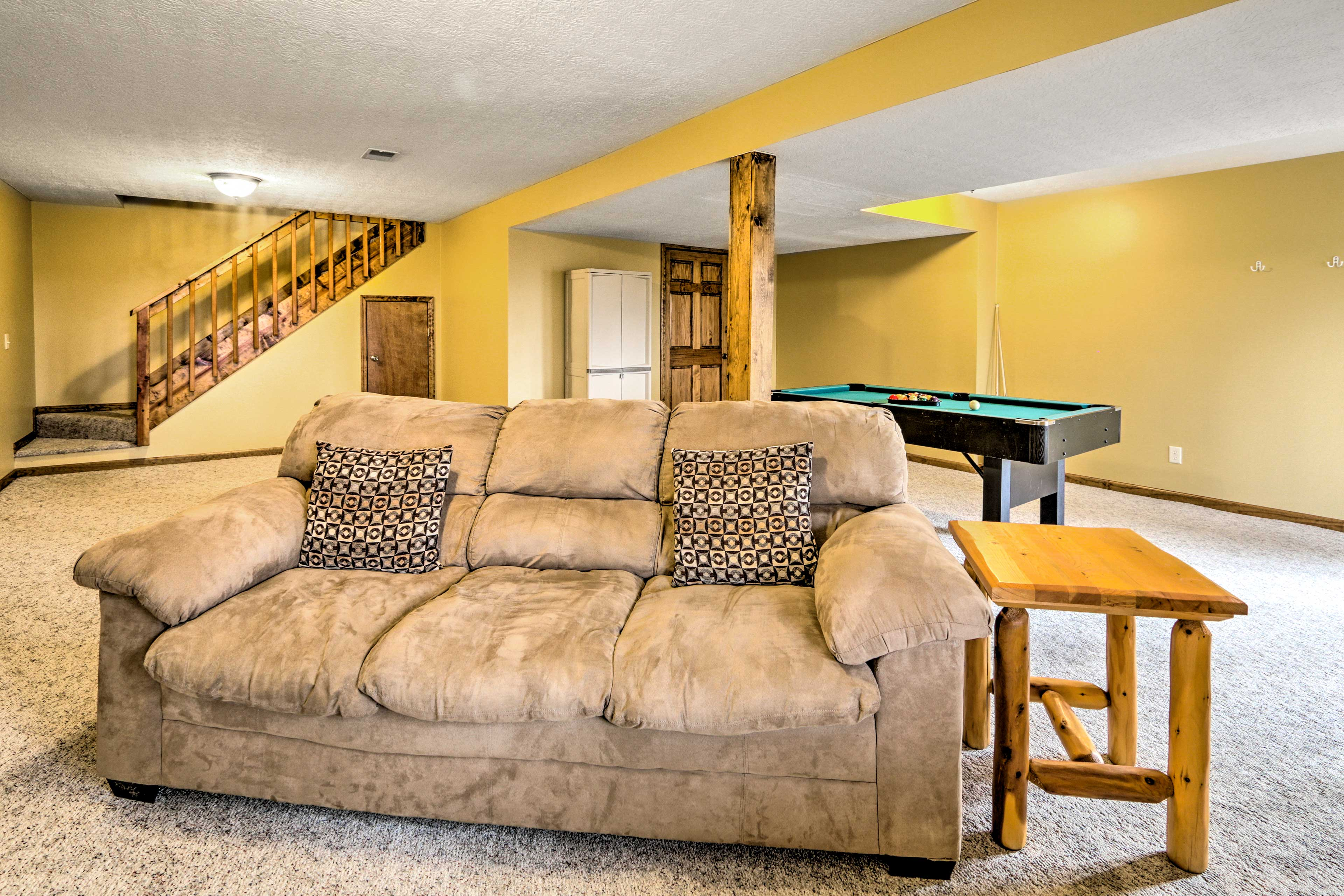 Head downstairs to discover a spacious living area complete with a pool table.